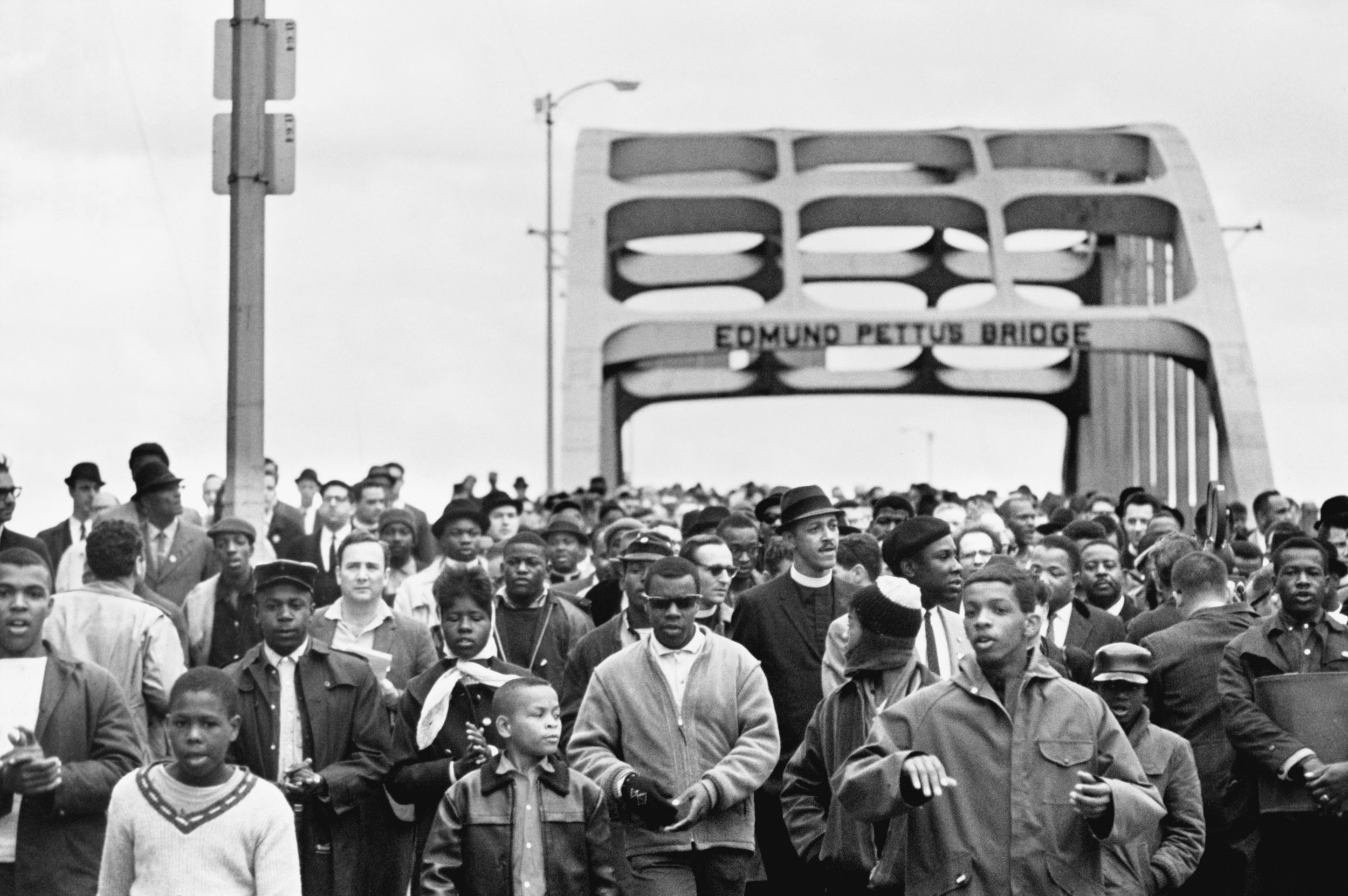 Here he is smack dab in the middle of that day's  most  iconic photo of Pettus Bridge. I am not sure he knew he had been immortalized in this photo; it would not have occurred to him to look for himself. (Flip Schulke / Corbis)