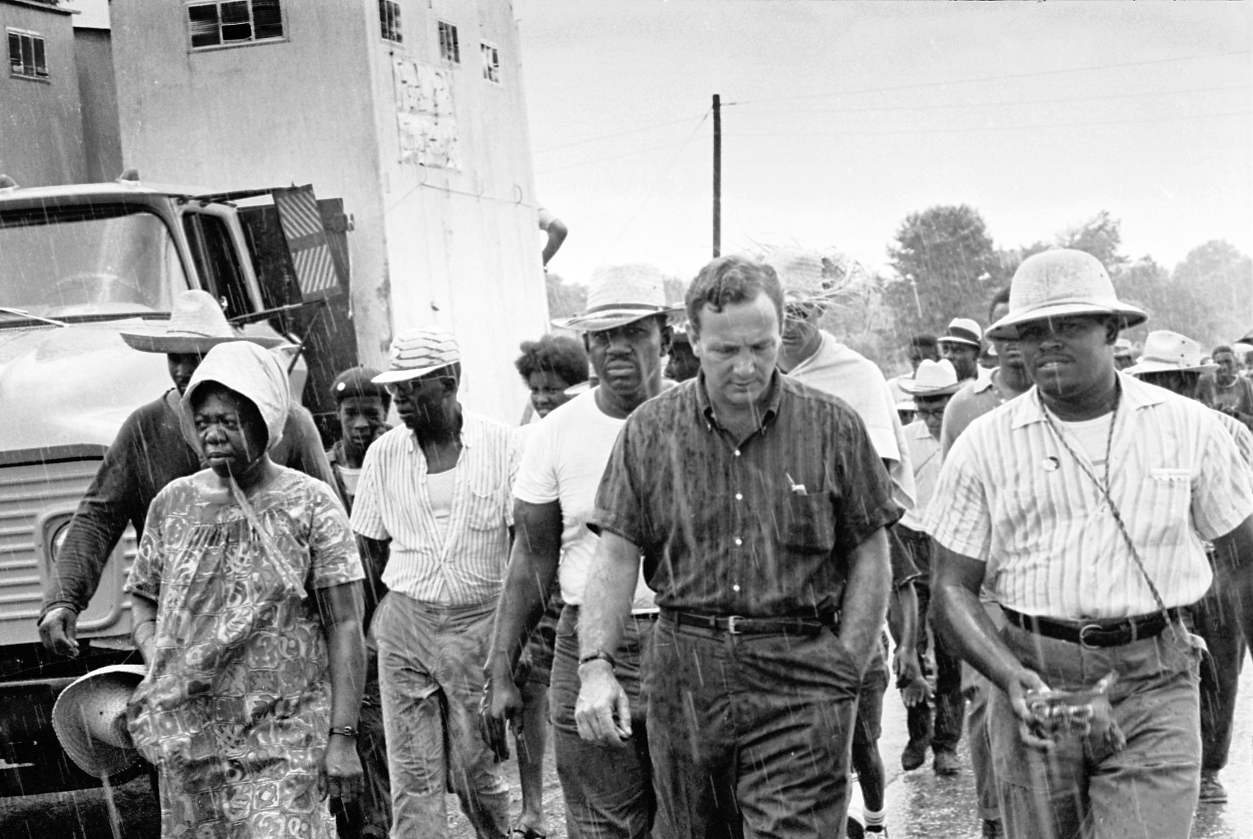 Here he is in the rain on the road from Selma heading to Montgomery. His physical form here knocks me out. How does a man die with such powerful arms? (The Image Works)