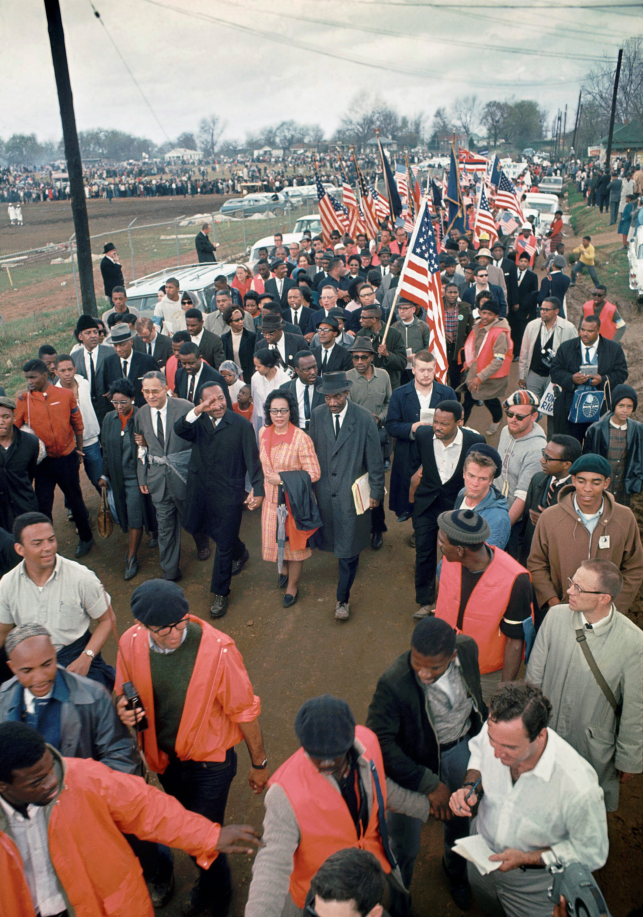Here he is in the final stage of the Selma March. My father has said something that has made people laugh, and Andrew Young is looking at him, as King and Coretta walk hand and hand behind them. The scene is alive with color, there are lots of flags and the reds are especially vivid, as if all are bloodied; it is the next best thing to having my father alive again. (The Image Works)