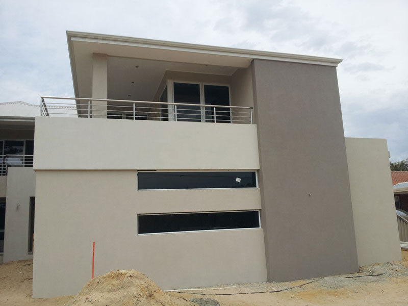Acrylic render with corbelling