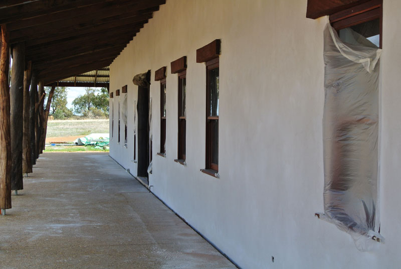Straw bale lime render