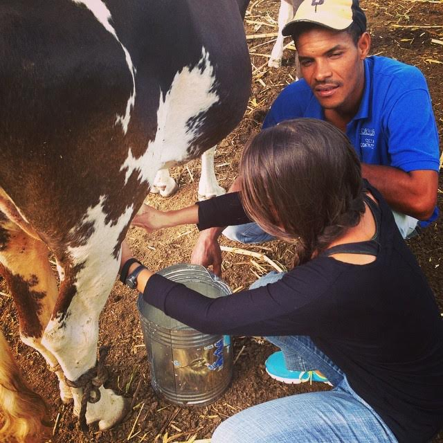 Me learning to milk a cow with help from an community member. They laughed when I ended up squirting milk all over myself. After we were done for the morning we all enjoyed freshly milked, boiled and then sweetened with sugar and chocolate milk! Doesn't get much fresher than that