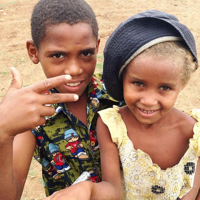 These two took a break from pumping water from their local well to pose for a picture