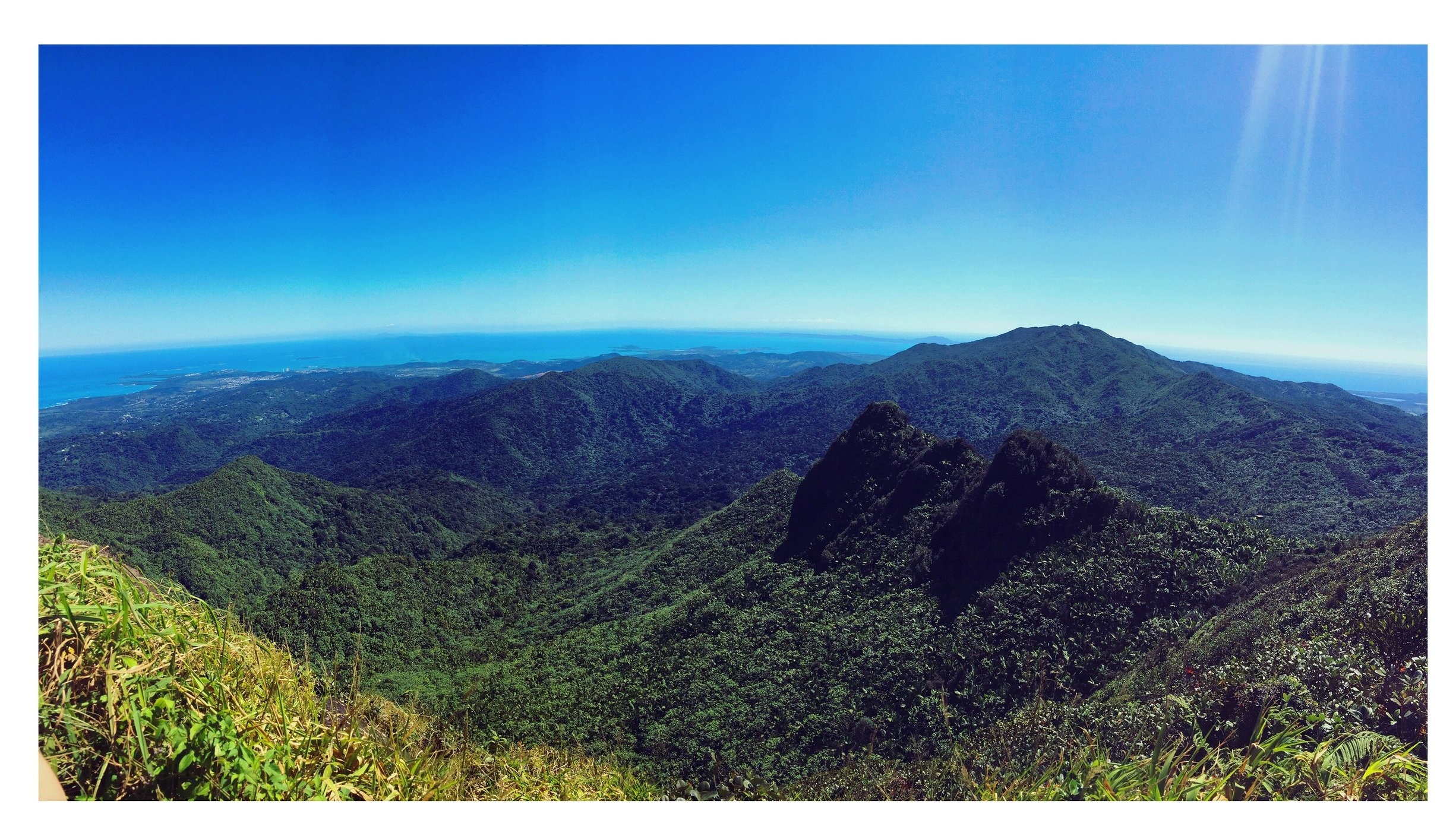 I signed up for an excursion to hike El Junque Rainforest through Dreamcatcher and met a lovely American couple on the tour. It was only the three of us and our tour guide Charlito, so it was super intimate.Charlito was very kind and took us on way more trails than he was obligated to.I took this shot from the summit of El Junque.Charlito said that he had not seen the sky as clear as it was on this day in months. It was so clear, that you could see the island of St. Thomas. It was breathtaking.