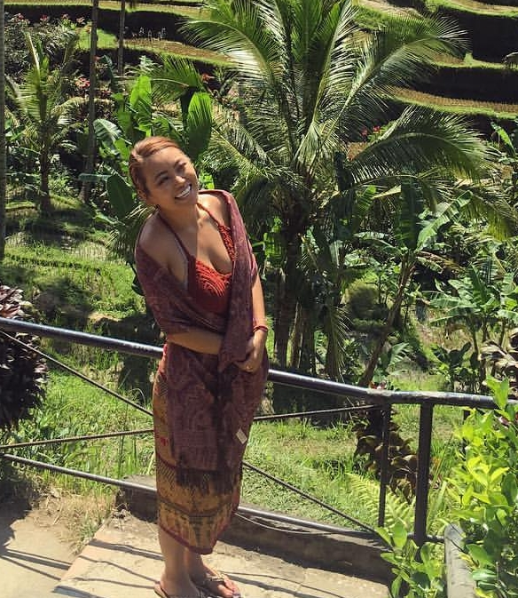 Jezzika standing in front of the fields in Bali