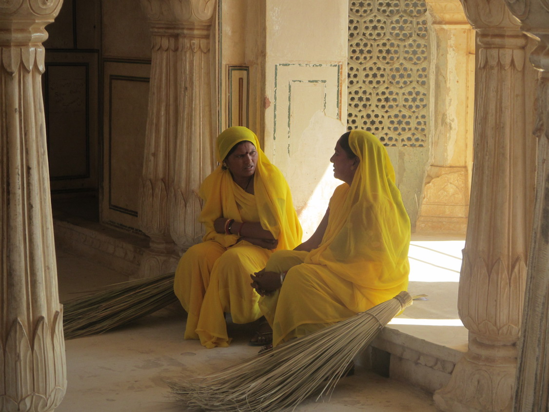 Two women sitting inside the City Palace in Jaipur.