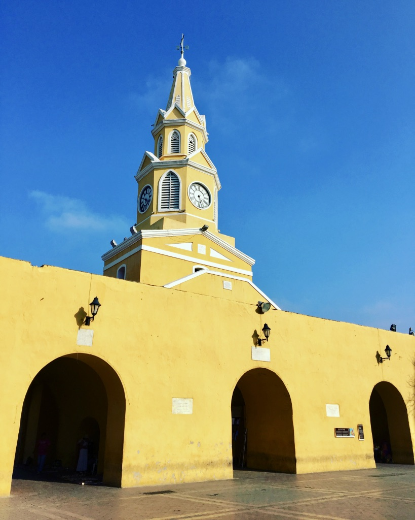 Old Town in Cartagena is surrounded by a stone wall. The entrance is this beautiful, colorful clock tower.