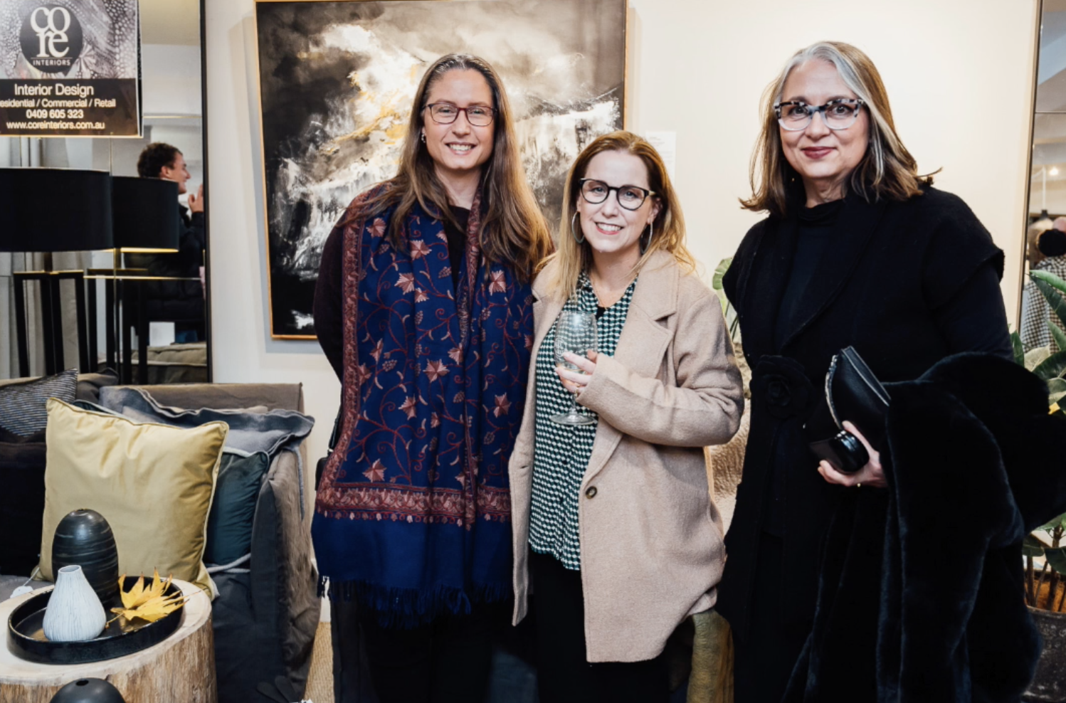 Jennifer Angelatos of Core Interiors [Right] collaboration capsule curated with BDA Interiors, Kylie Fogarty [Centre] - Artist painting [on wall behind], MCM House furniture range, Cadry's Colorscope rug collections & ceramicist' Tanya McArthur [Left] works [on table].