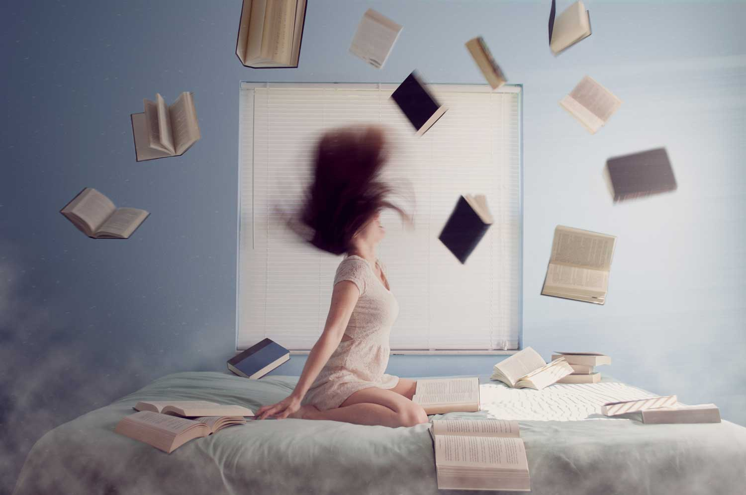 frustrated person throwing books