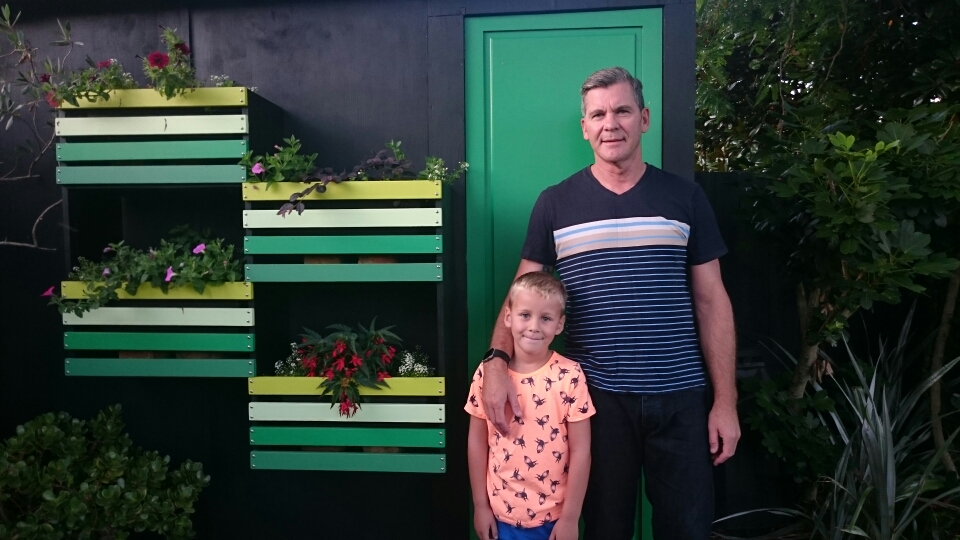 John and his grandson Eli enjoying the colourful living wall in their garden