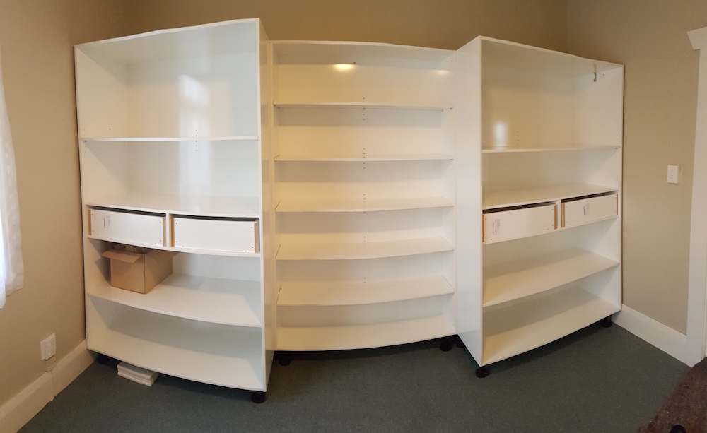 The cabinet with the hidden shelving before the pivot door is attached