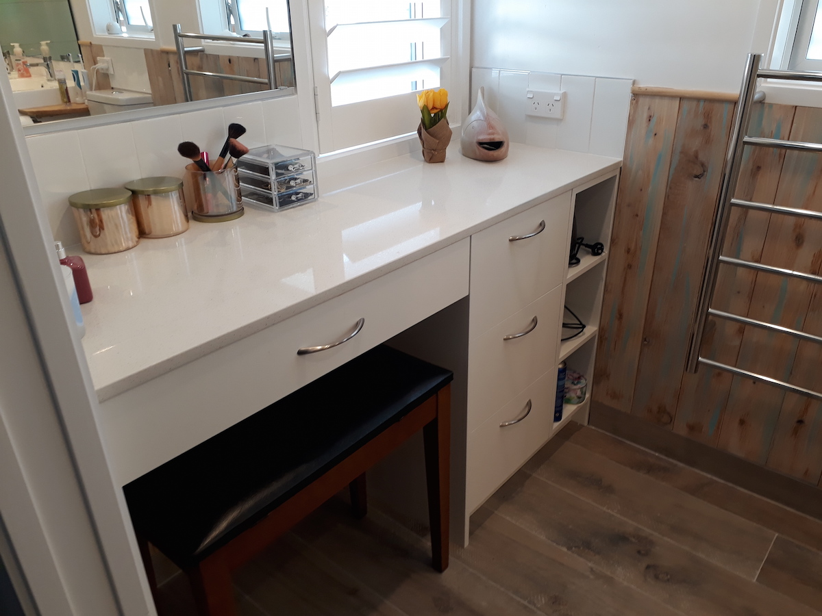 """The vanity unit had to be cut to exact measurements — there was no room for error. It fits perfectly in the small space between two walls and an end wall and the quality is excellent"""