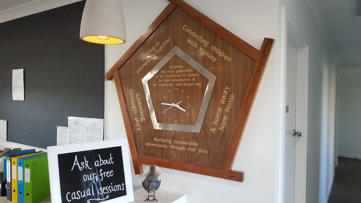 The clock which hangs proudly in The Pentagon's reception as a permanent reminder to parents and caregivers of the Centre's special character.