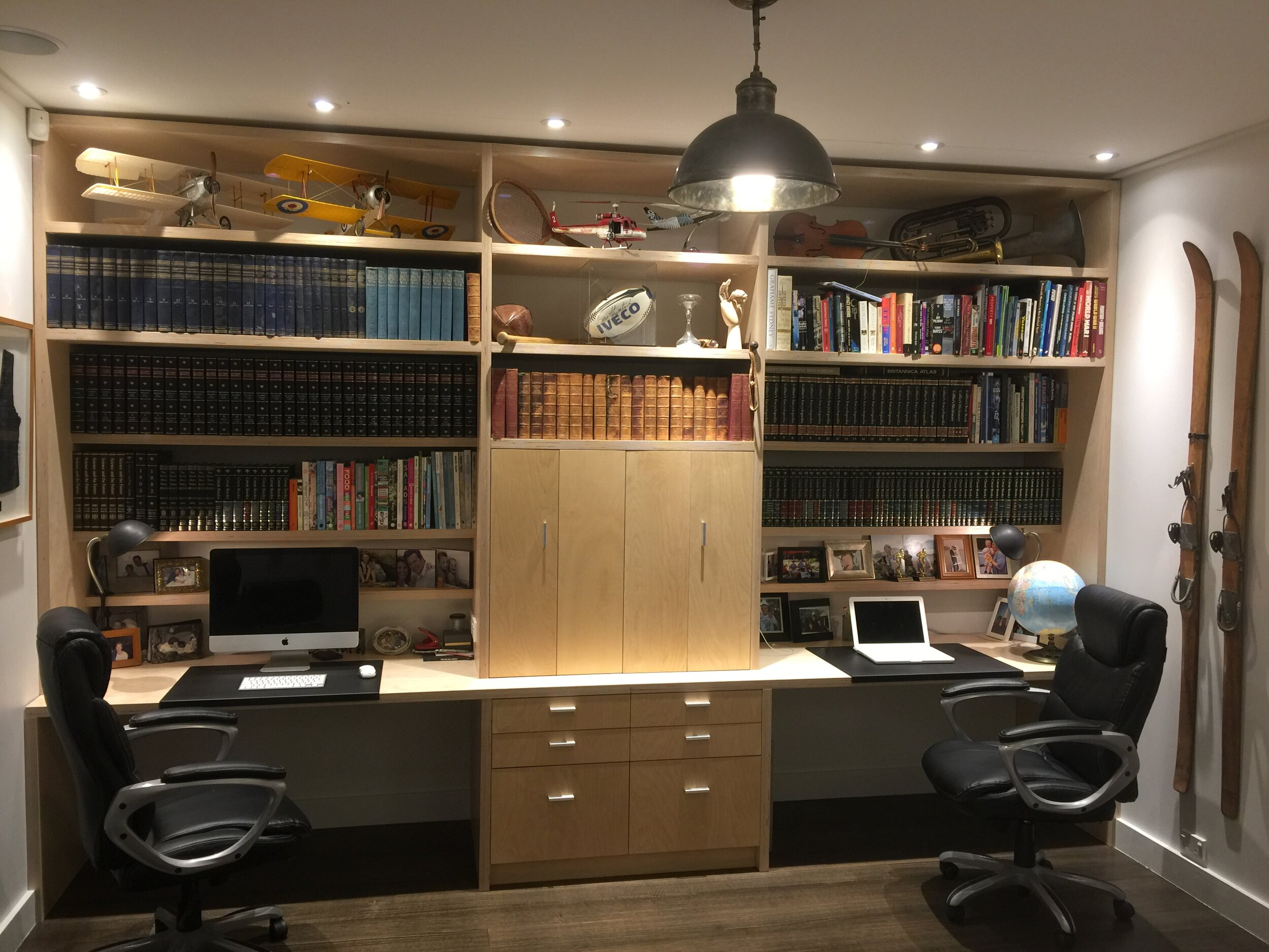 Bespoke desk, shelves and cabinets for a home library.
