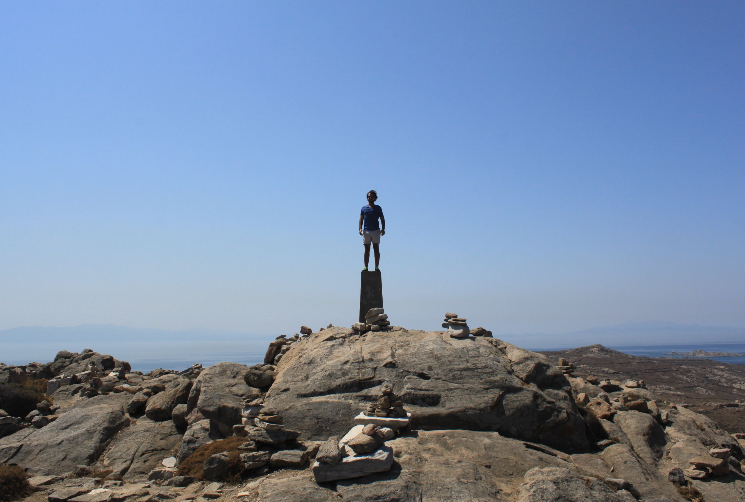 Standing on the tallest point of the archaeological island of Delos.