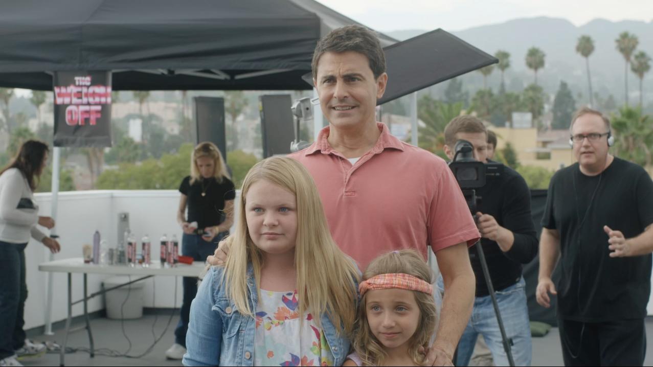 Bradley White, Kate West & Peyton Ella as Claire's family