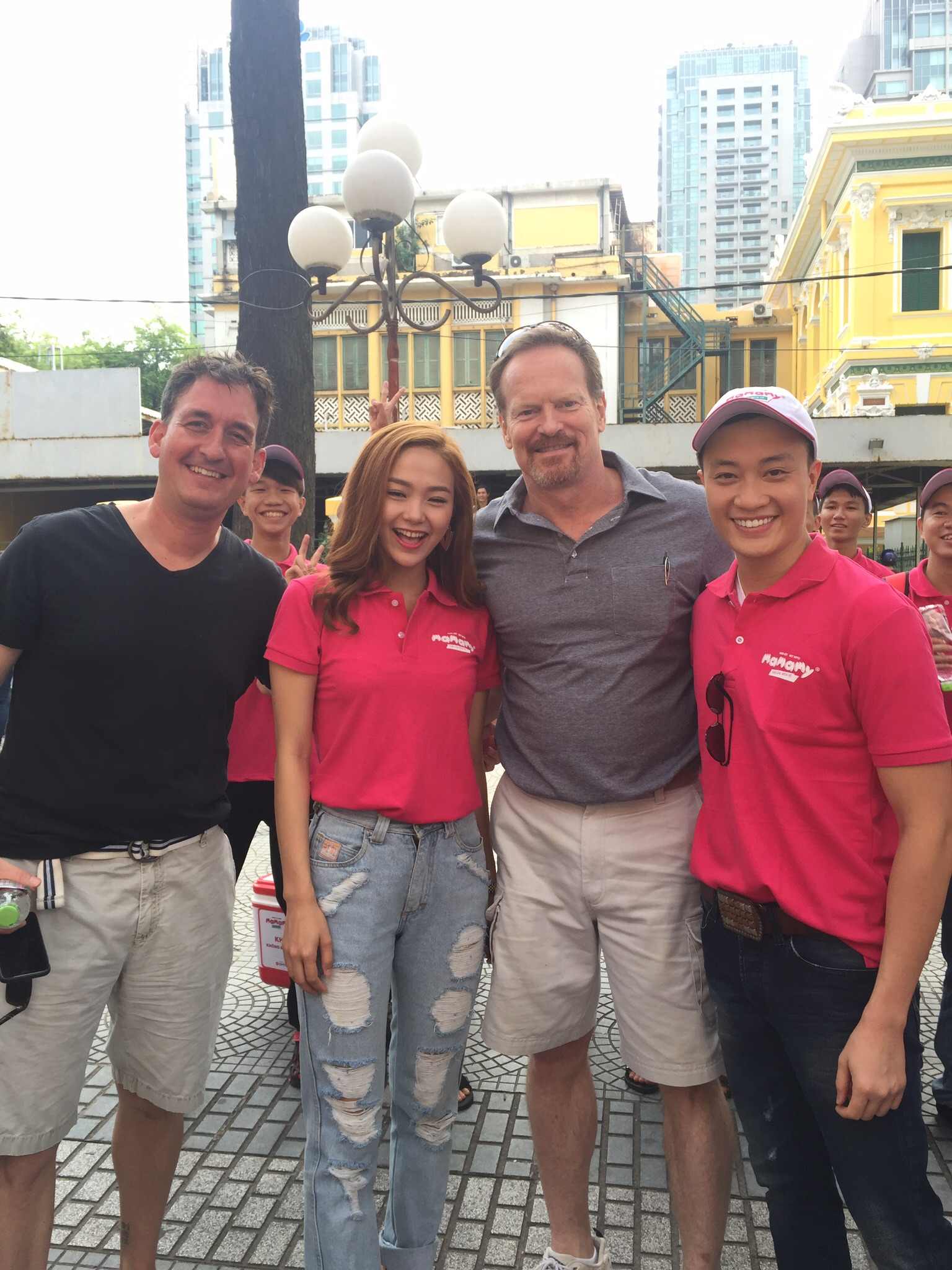 Dr. Robert Bayless, Michael Droege, and Minh Hang and Lương Mạnh Hảicelebrating water!