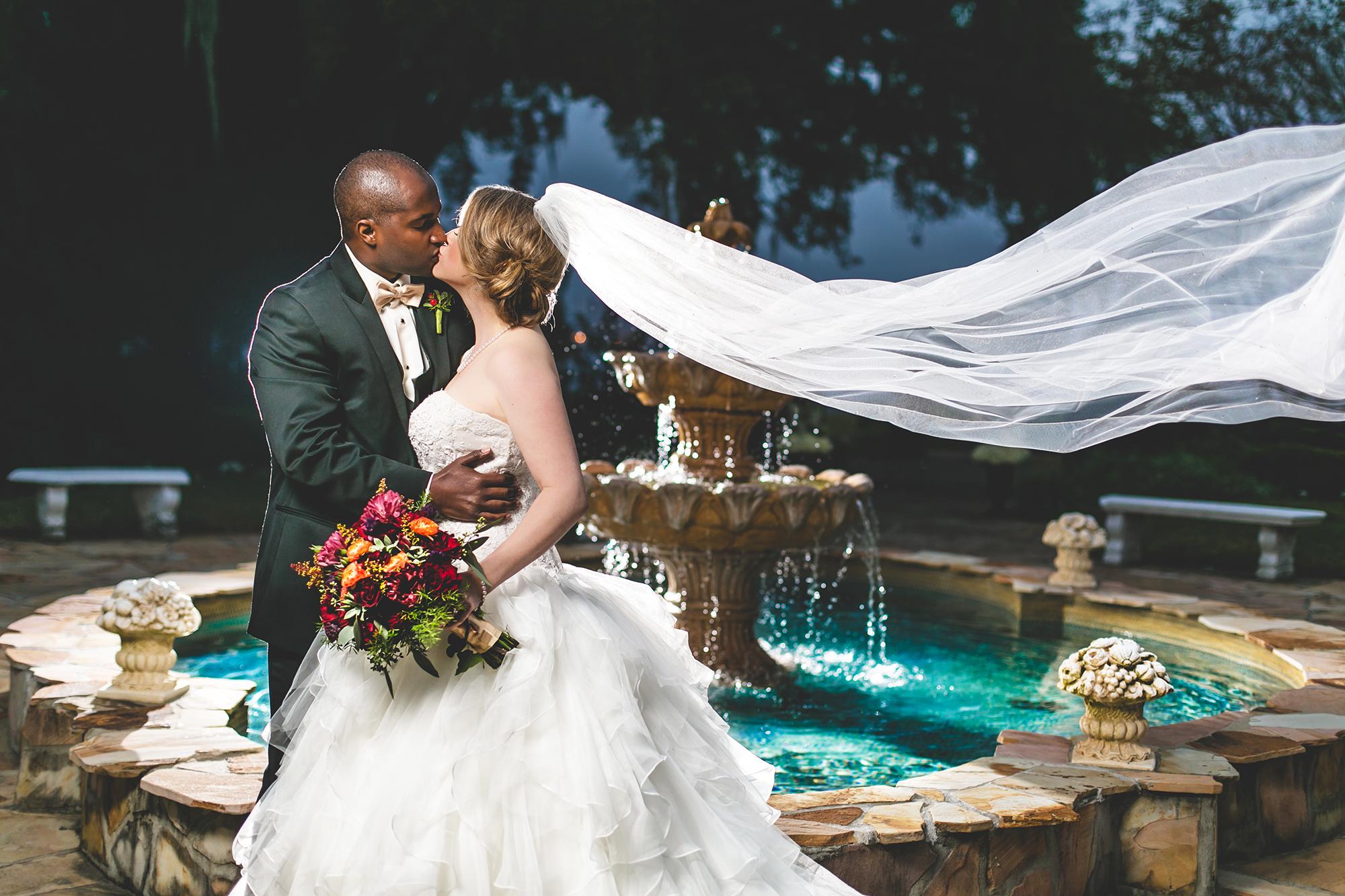 adam-szarmack-wedding-bride-groom-kiss-fountain.jpg