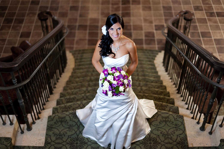 adam-szarmack-wedding-bride-stairs-smile.jpg