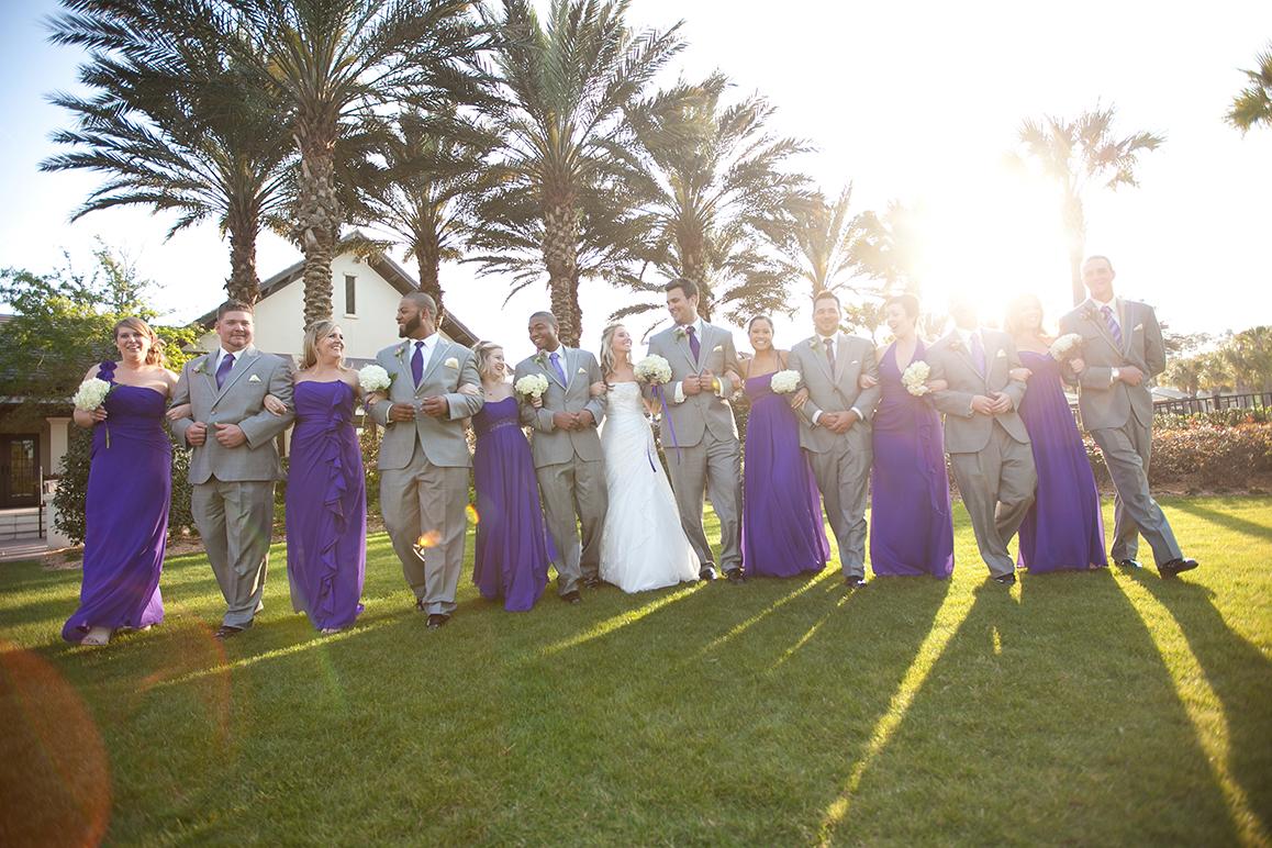 adam-szarmack-wedding-party-linked-arms.jpg