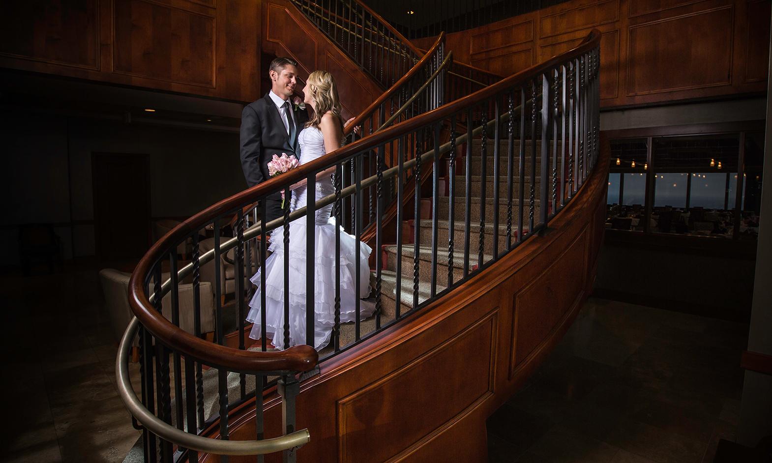 adam-szarmack-wedding-spiral-staircase-bride-groom.jpg