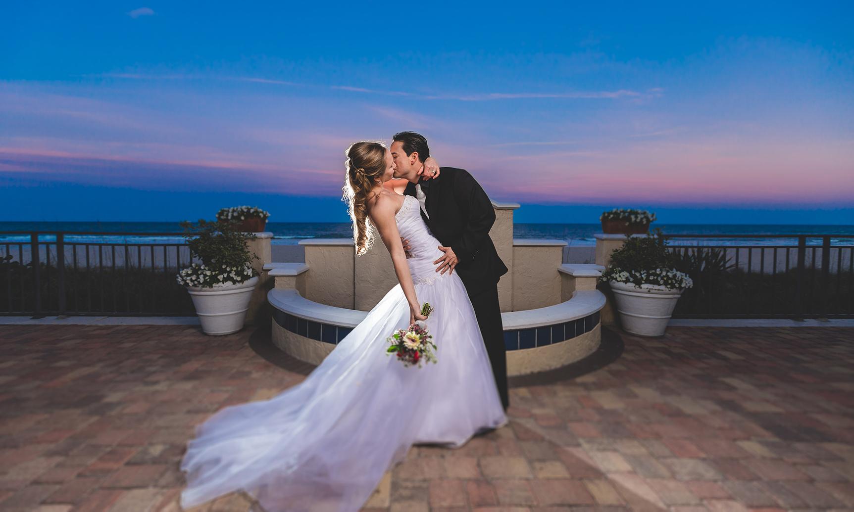 adam-szarmack-wedding-sunset-dip-kiss.jpg