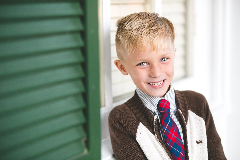 adam-szarmack-engagement-family-boy-smile-doors.jpg