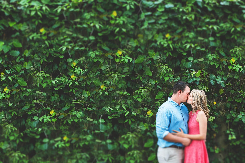 adam-szarmack-engagement-kissing-ivy-wall.jpg