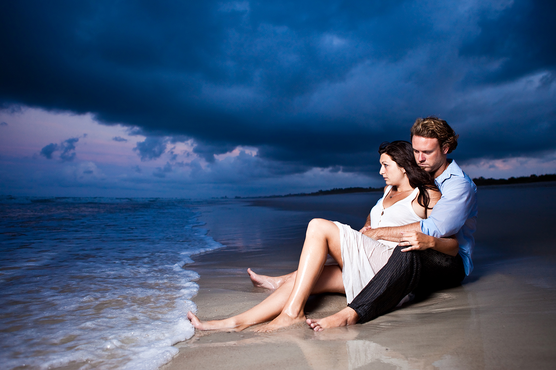 adam-szarmack-engagement-storm-clouds-beach.jpg
