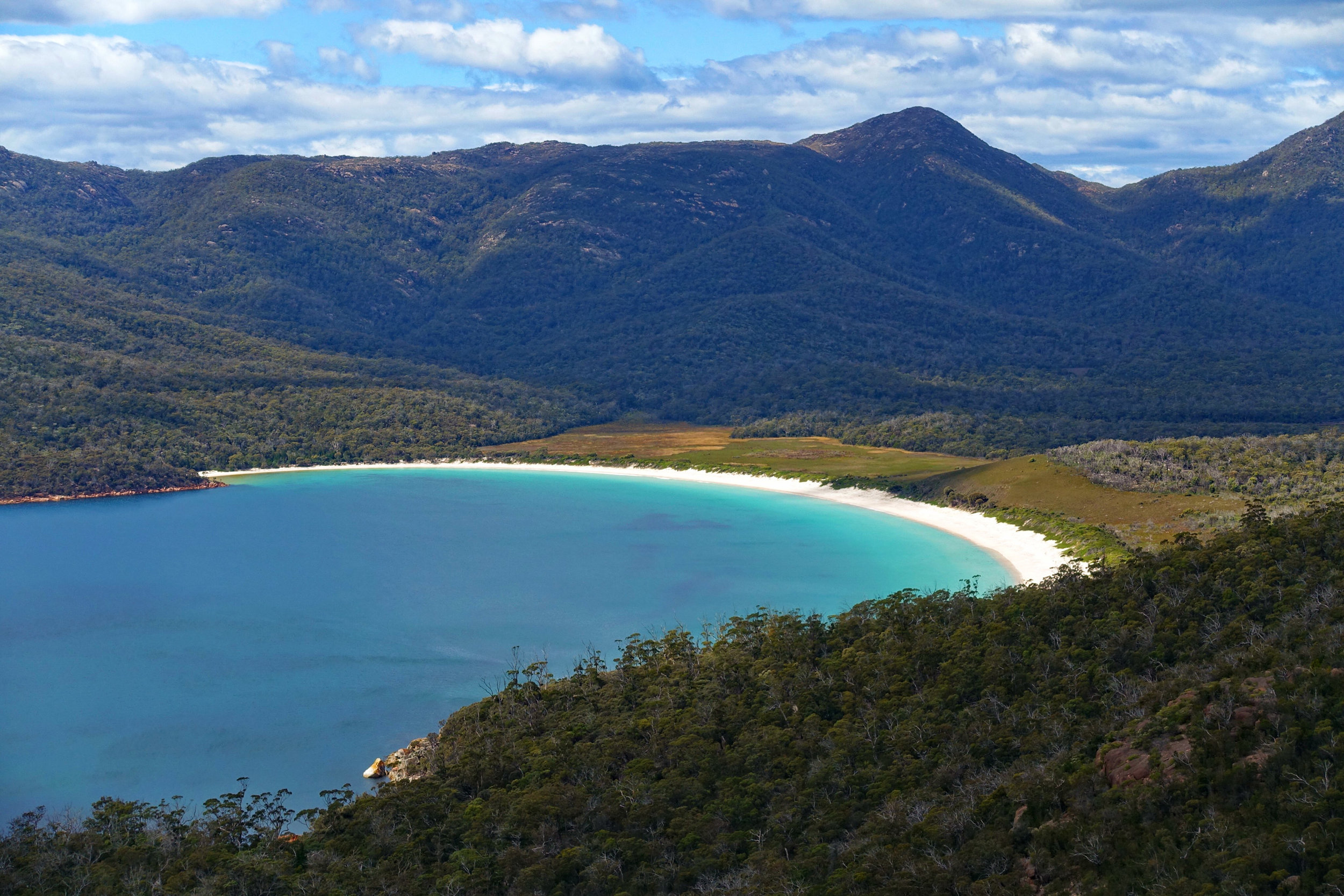 3.)Freycinet National Park - The Wineglass Bay and Hazards Beach loop in Freycinet National Park, has some gorgeous spots for camping. While the track is popular with day-walkers, taking the longer routes mean you can enjoy the pristine beaches to yourself. For any multi-day hikes, make sure you carry plenty of water with you.
