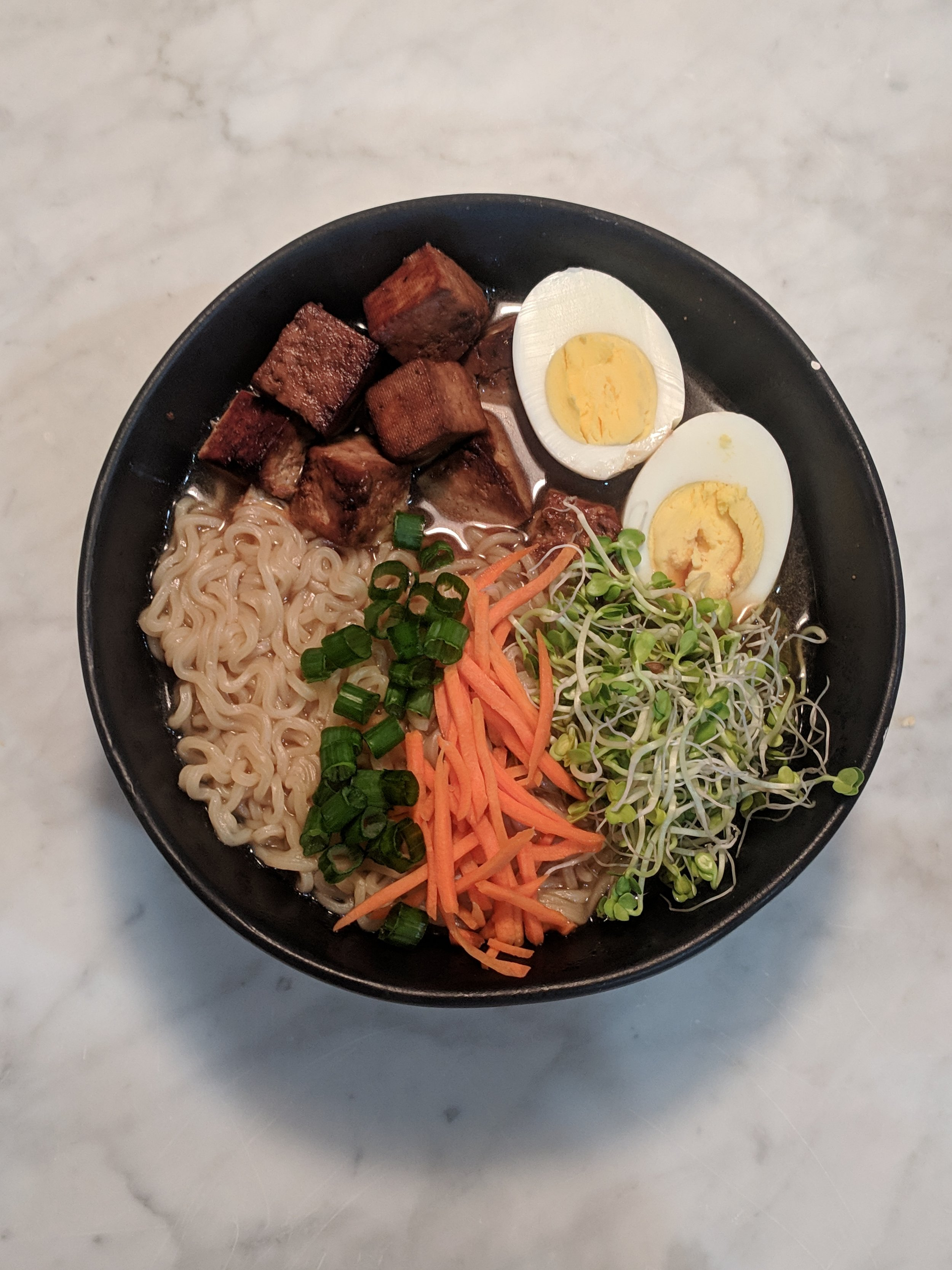Loaded Ramen Bowl - Let's face it, there is no bad time for ramen! Liven up a plain ramen pack with tofu, eggs, veggies and of course SPROUTS!Recipe:One pack of ramenPan fried tofuA hard boiled eggGreen OnionShredded CarrotsRadish Sprouts!