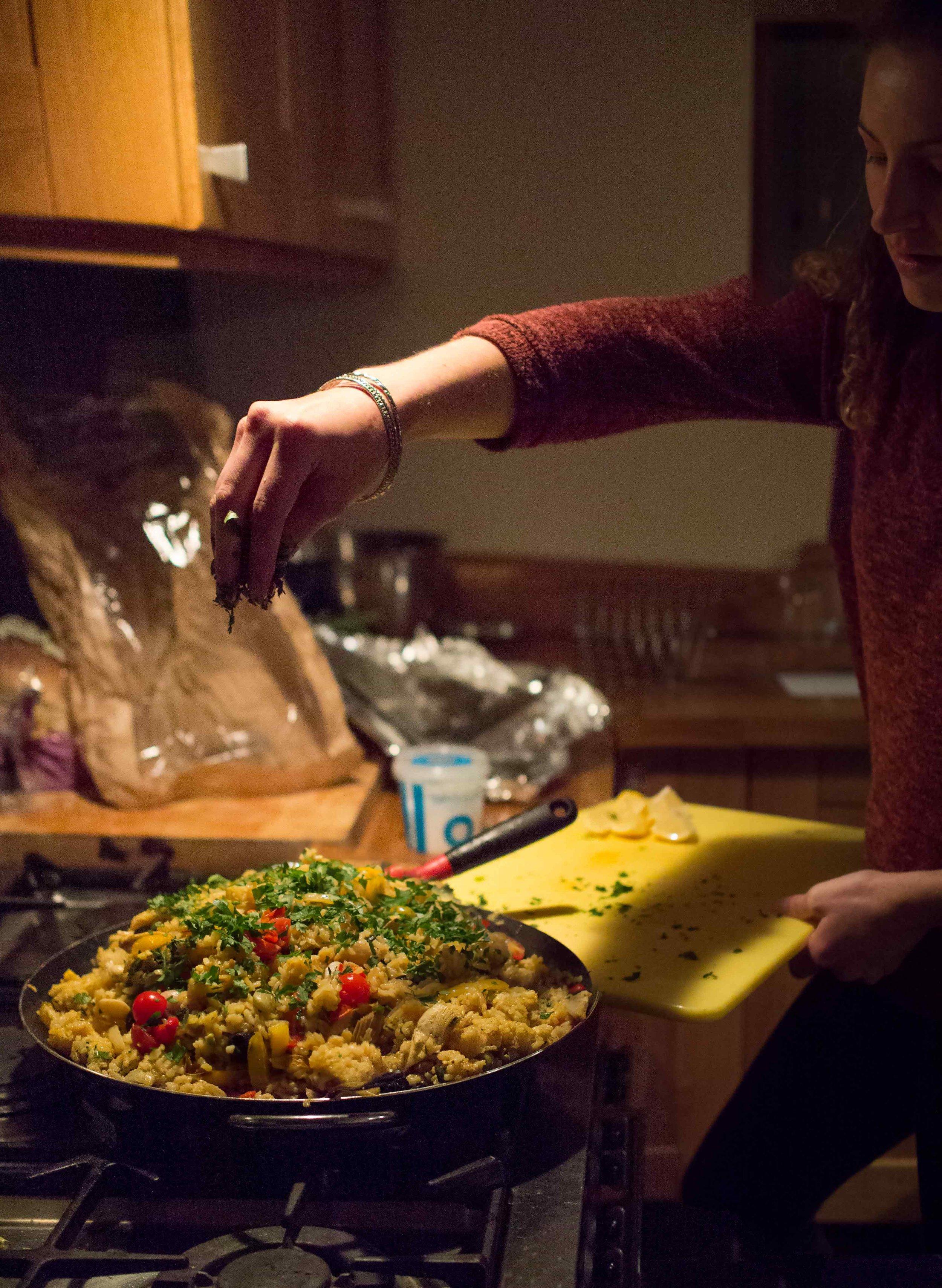 Dinner is served. My friend Svenja producing this amazing pepper & broad bean paella.