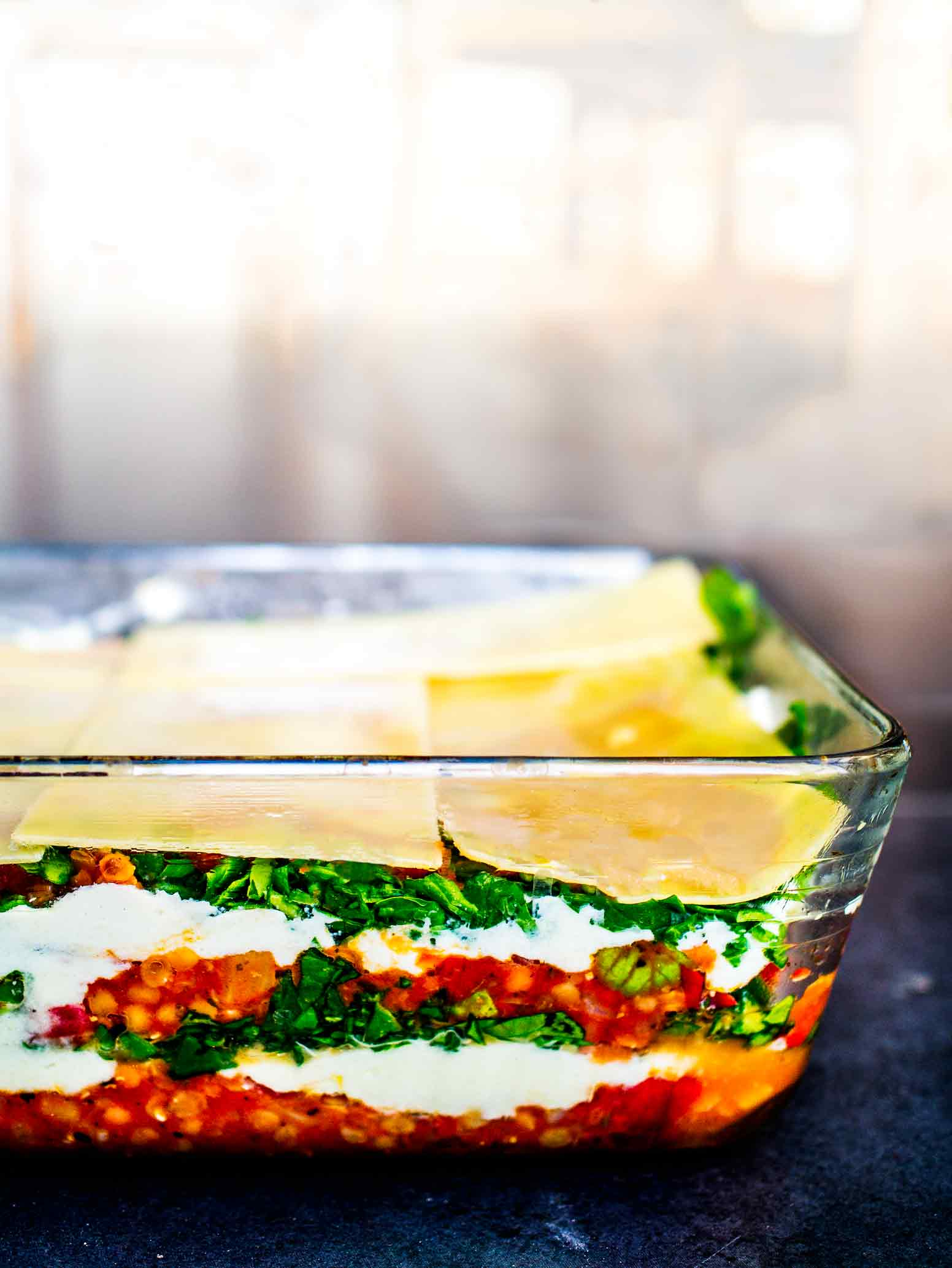 This Vegan Lasagne is super satisfying and a perfect dinner party dish. Perfect to make for the week or to freeze portions, too. #lasagna #vegetarian #best #healthy #recipe #lentil #spinach