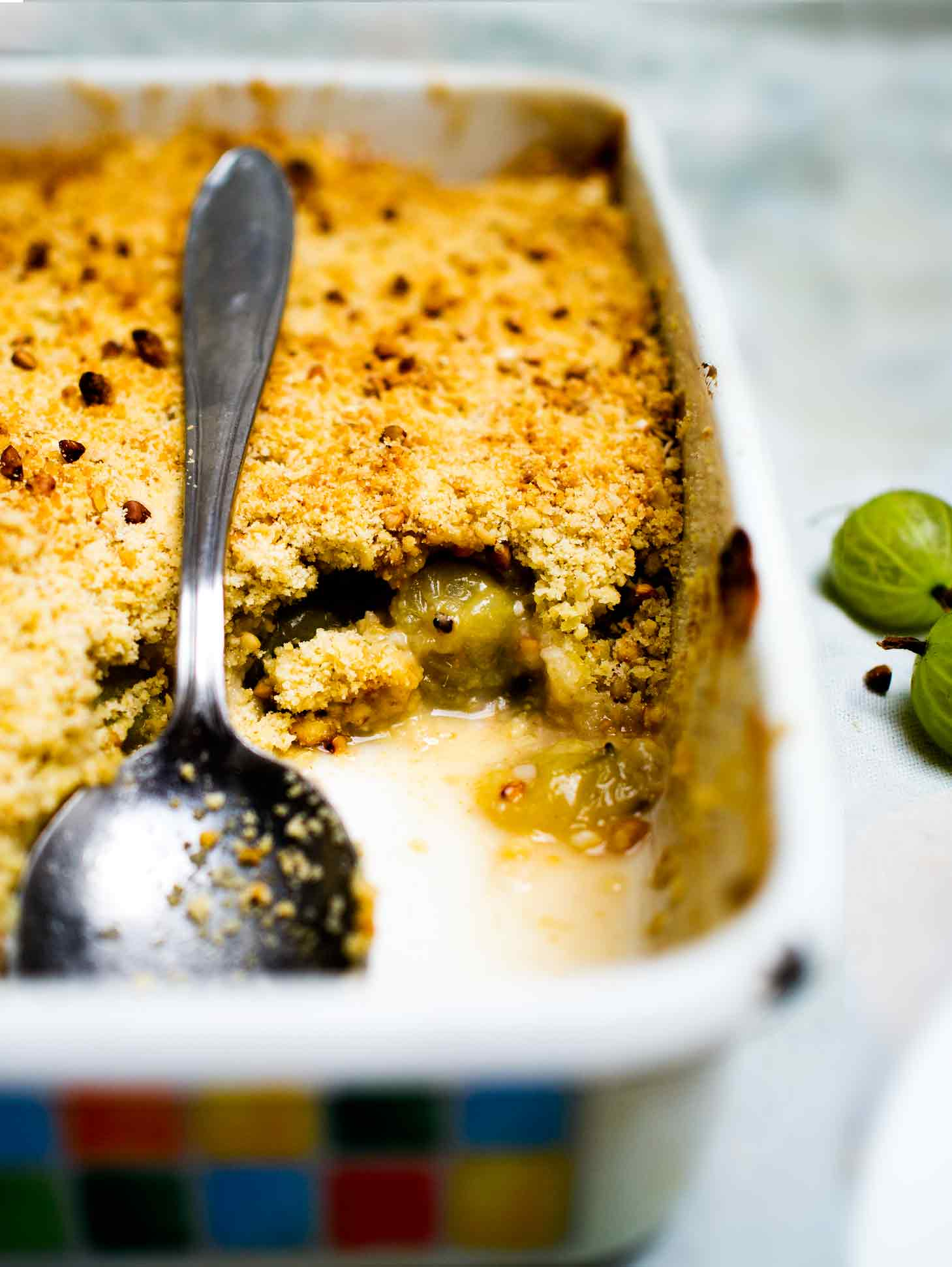 This Gooseberry Crumble is sharp and sweet with a lovely almond flavour and nice texture from the oats and buckwheat in the topping! #vegan #dessert #crisp #fruit #easy #recipe