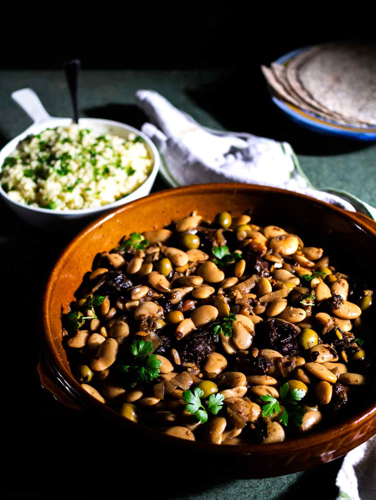 This Tagine of Butter Beans, Almonds and Prunes is so delicious - sweet and sour, filling, healthy and 100% vegan! #moroccan #couscous #gluten #free #recipe #recipes #middle #eastern #vegetarian