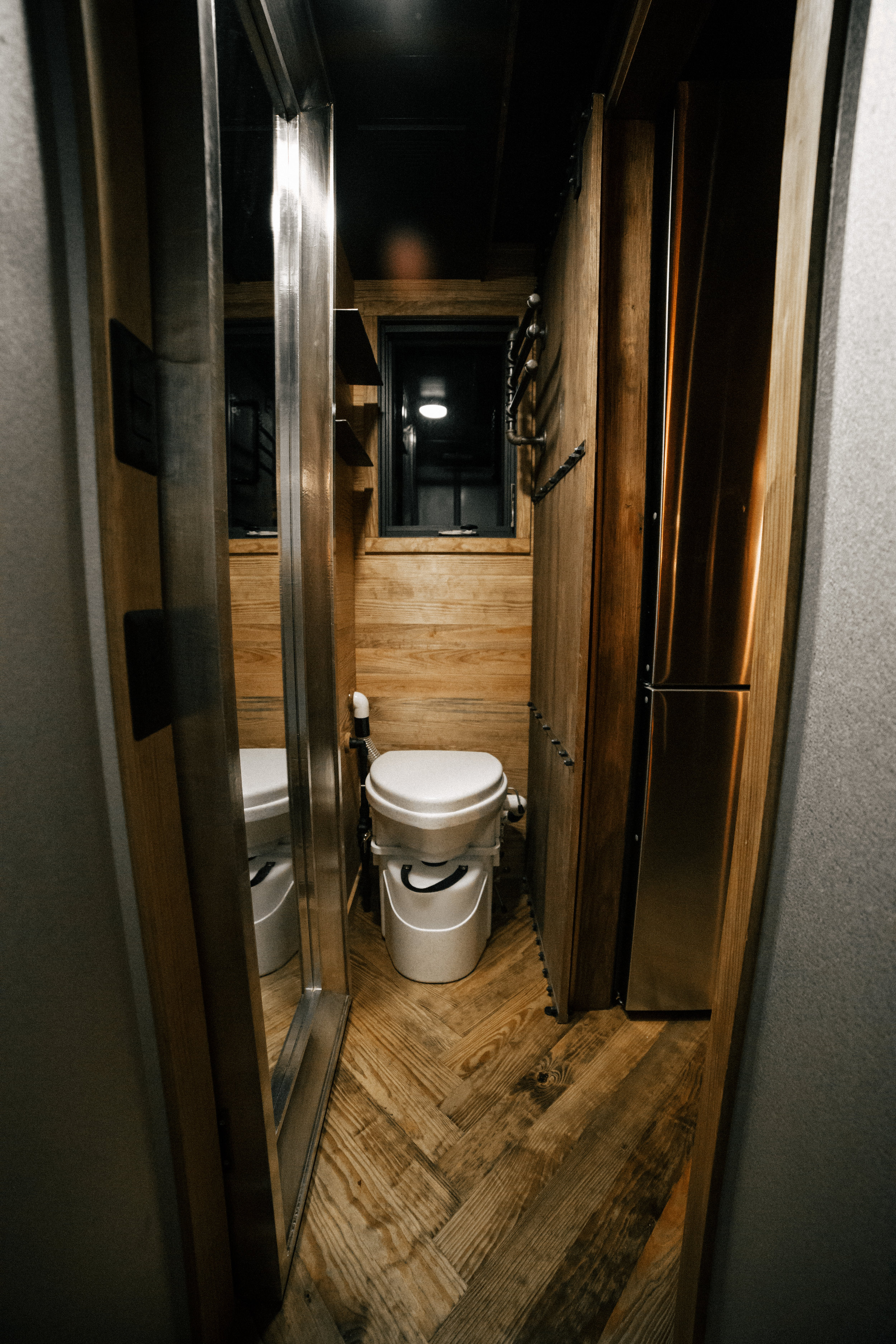 The Rook by Wind River Tiny Homes - Bathroom with Nature's Head Composting Toilet.