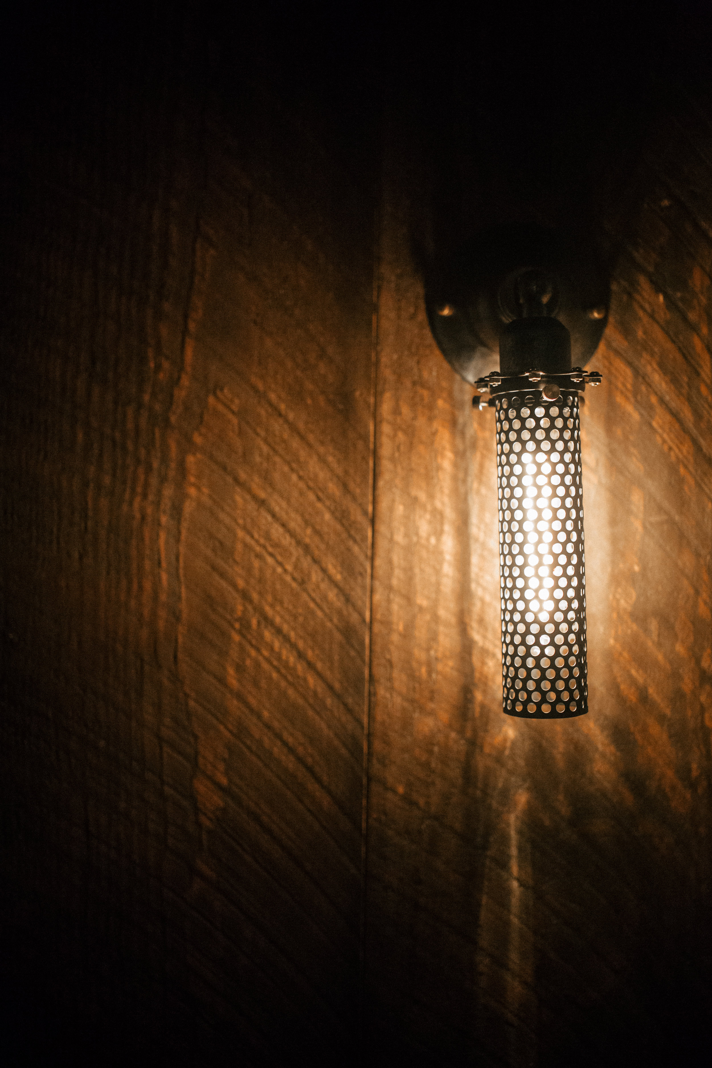 The Rook by Wind River Tiny Homes - Edison bulb sconce lights.