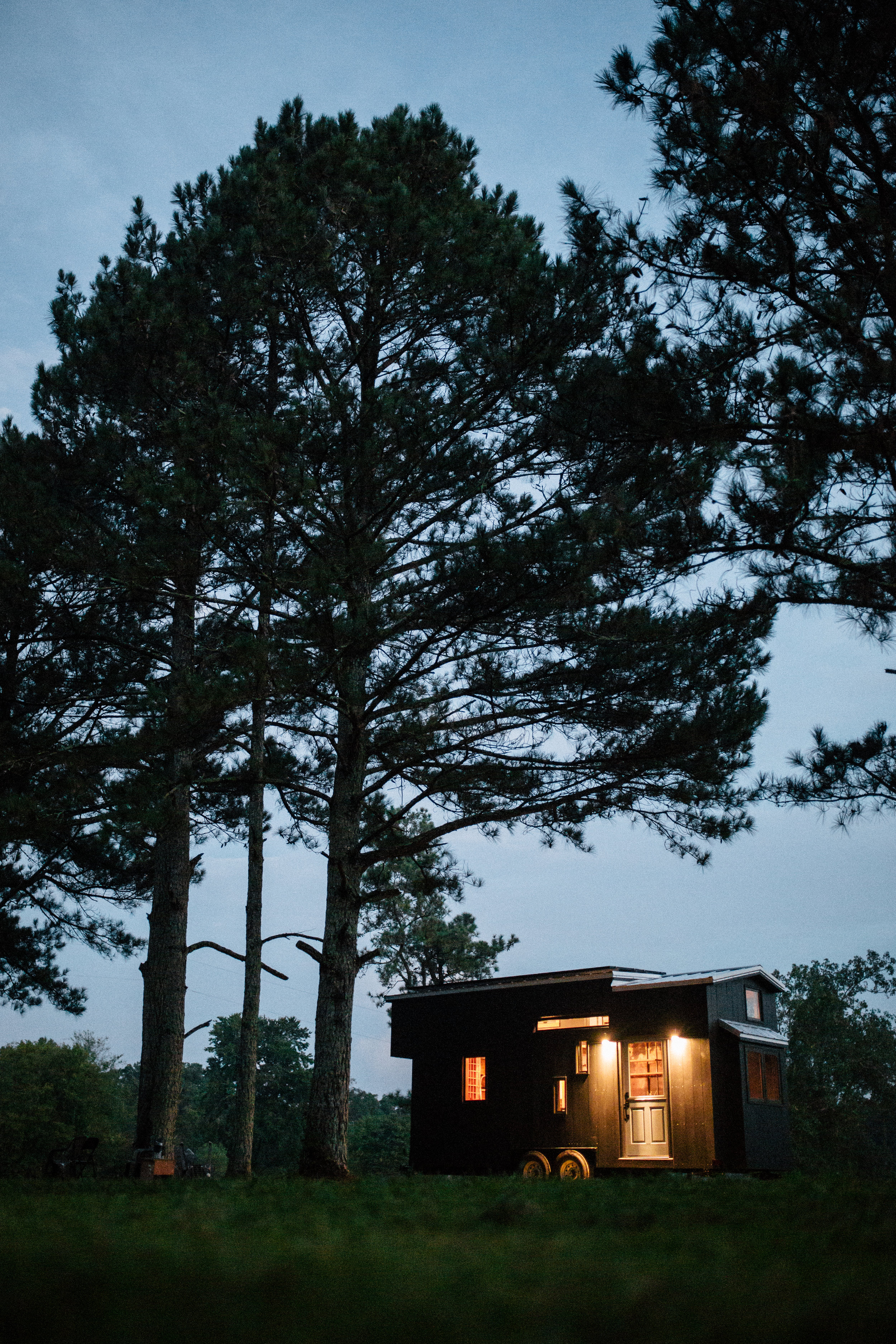 The Rook by Wind River Tiny Homes - Painted vertical siding with exposed stainless screws and custom roofline.