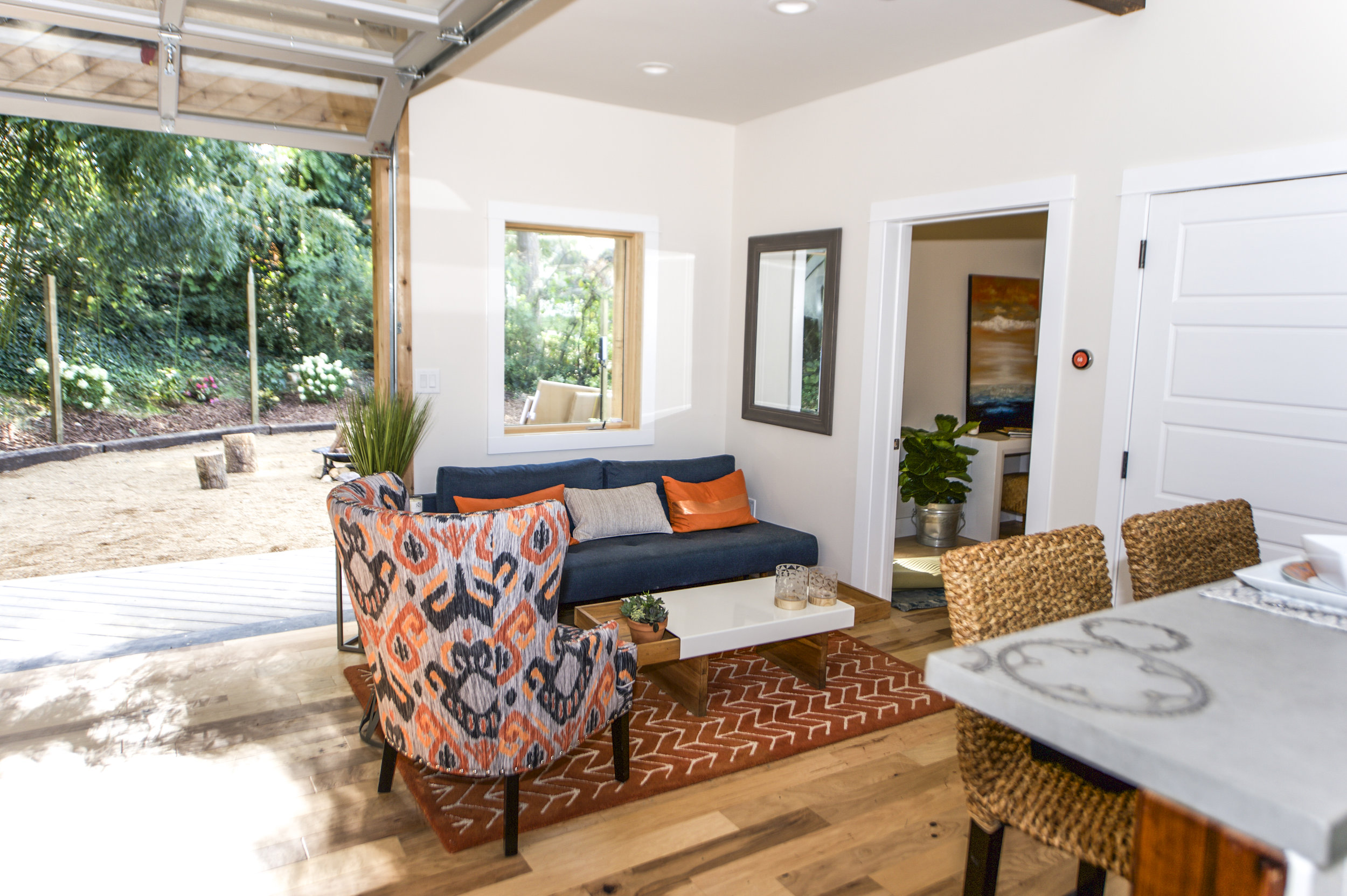 Urban Micro Home by Wind River Tiny Homes - glass garage door by Chattanooga Garage Door, concrete counters by Set In Stone, inlaid bike gears