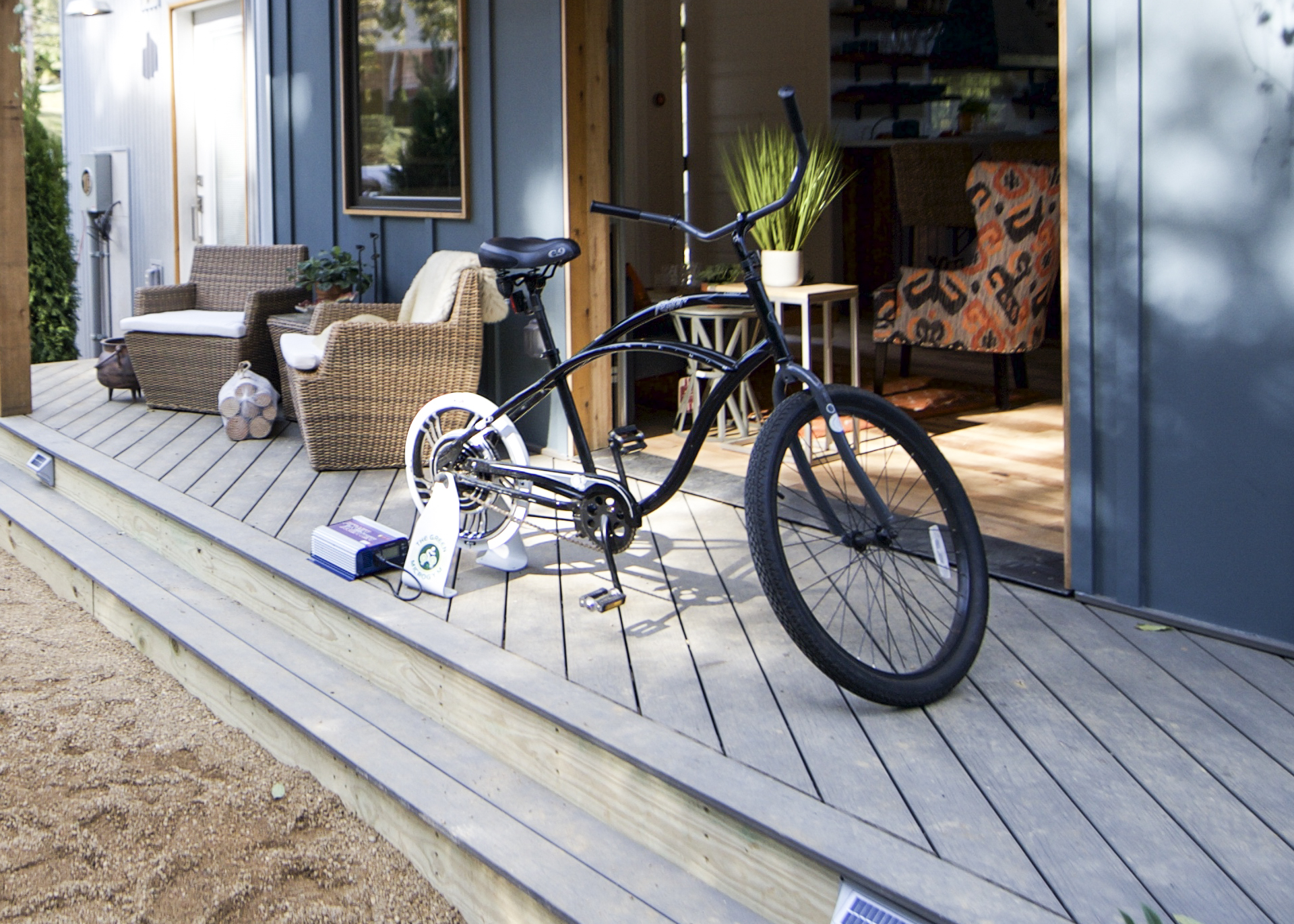 Urban Micro Home by Wind River Tiny Homes - glass garage door by Chattanooga Garage Door, bicycle that generates and stores power by Green Microgym, hooks up to most bikes