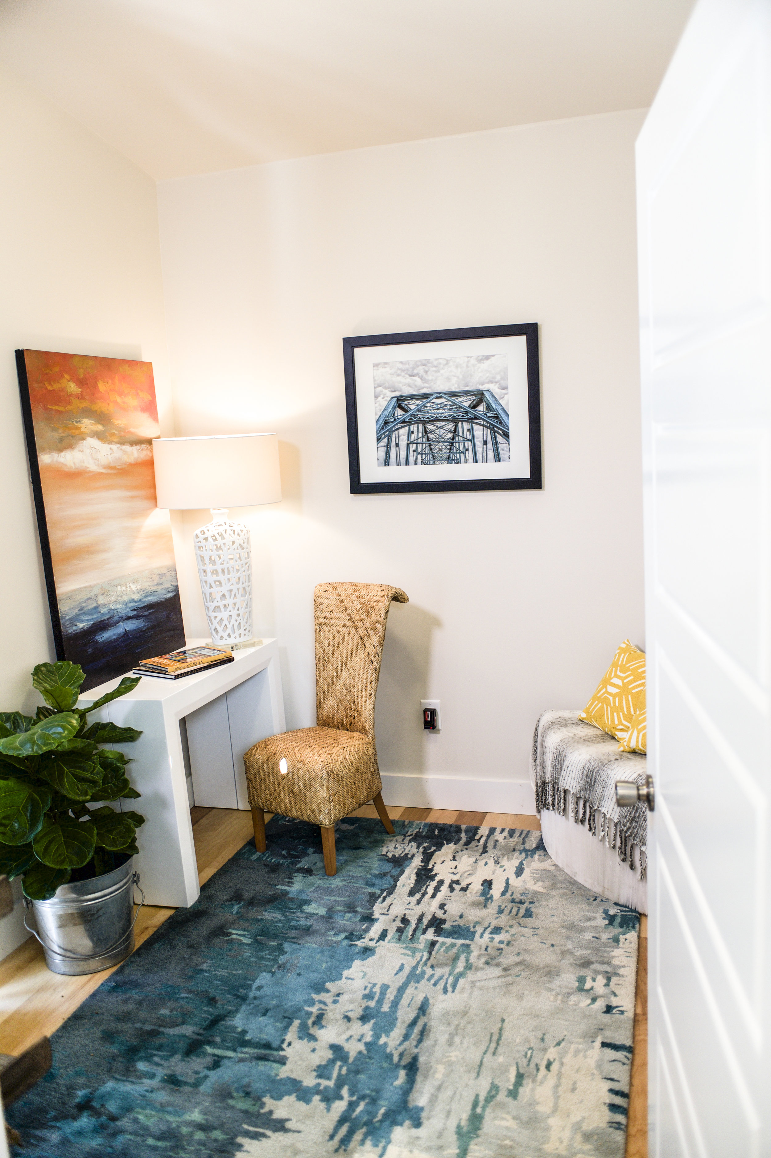 Urban Micro Home by Wind River Tiny Homes - Downstairs office with Junior Giant Table and Flexible Love Seat by Expand Furniture