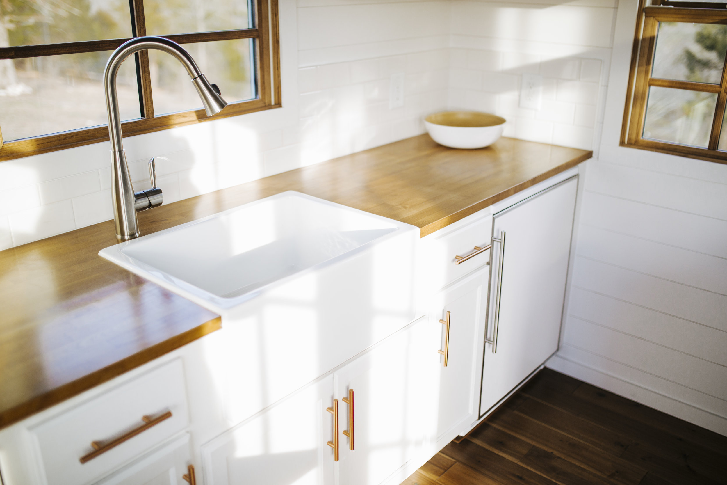 The Monocle by Wind River Tiny Homes - farmhouse sink, butcher block countertops, shiplap siding