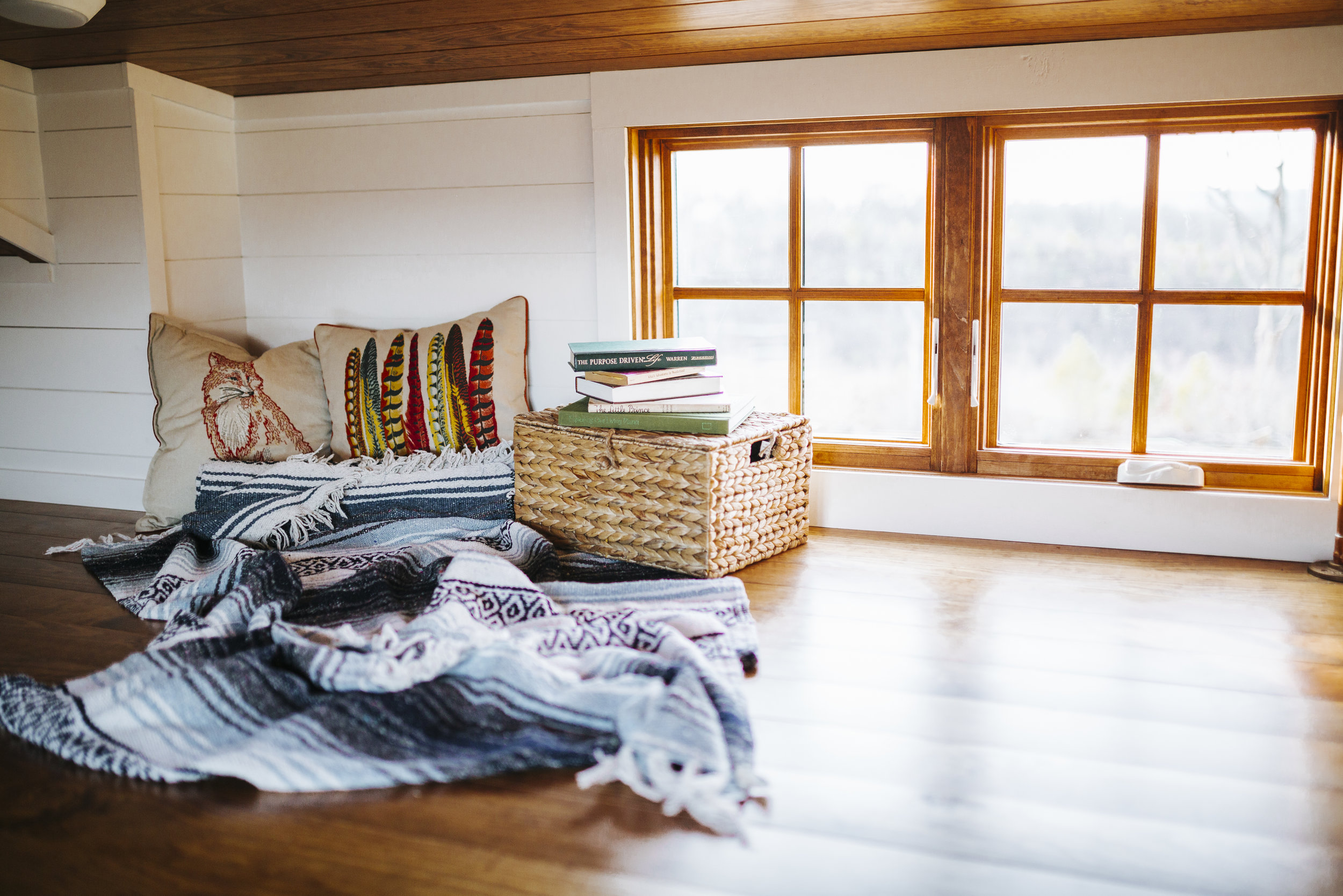 The Monocle by Wind River Tiny Homes - loft, wood clad windows