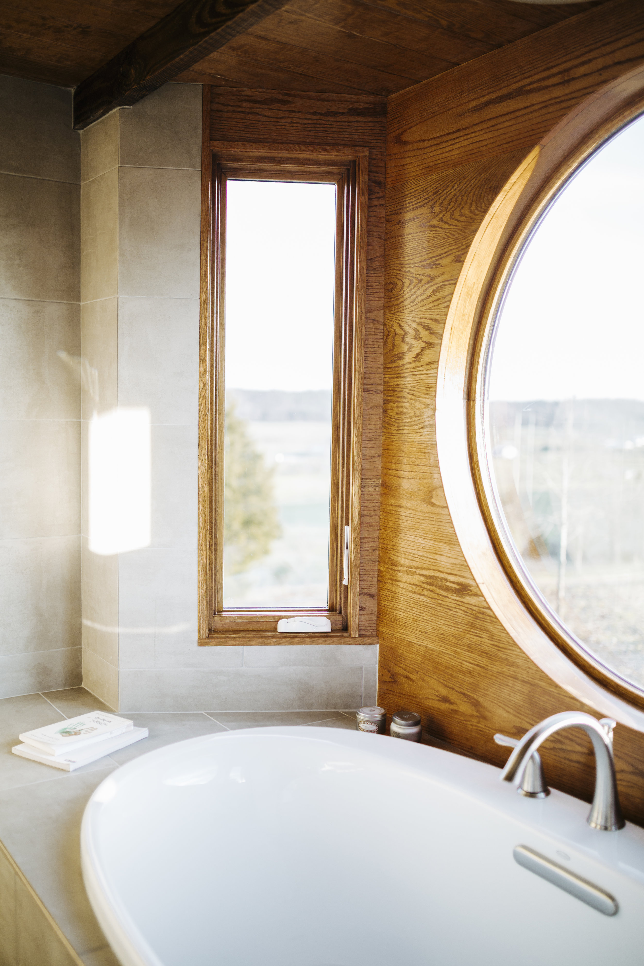 The Monocle by Wind River Tiny Homes - bath tub, mixed tile and oak, wet bath
