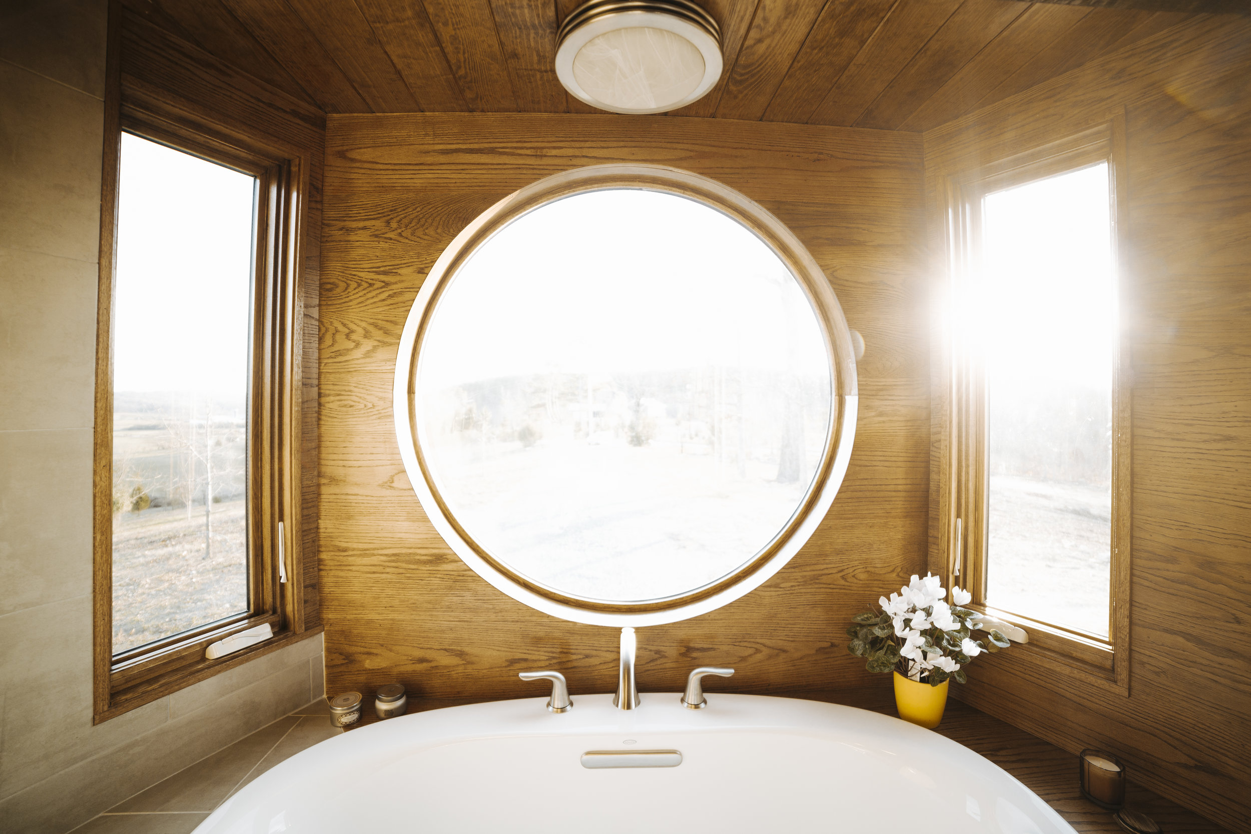 The Monocle by Wind River Tiny Homes - bath tub, wet bath, mixed tile and oak tub surround