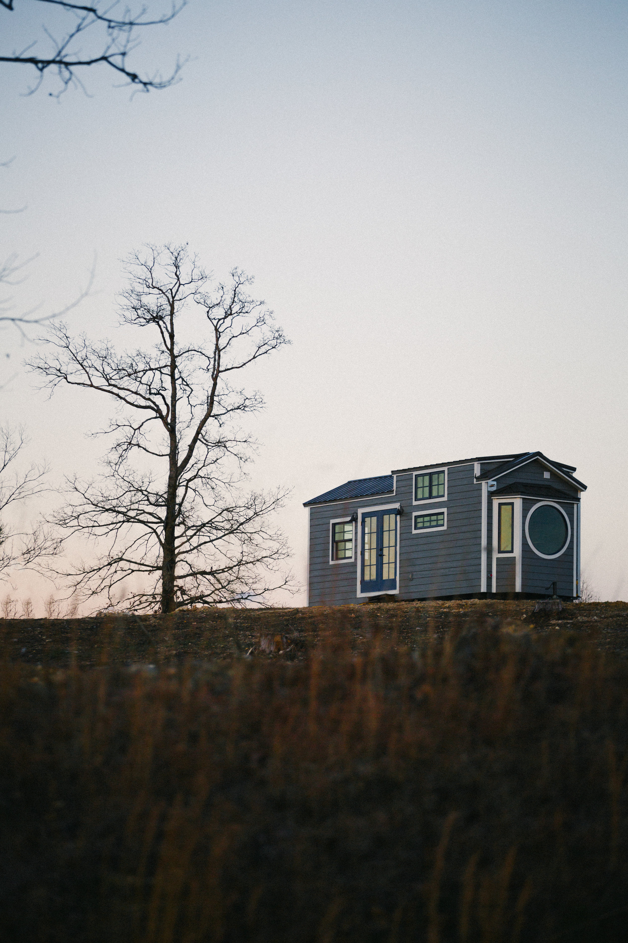 The Monocle by Wind River Tiny Homes - LP smartside, metal roof, 10 foot wide design