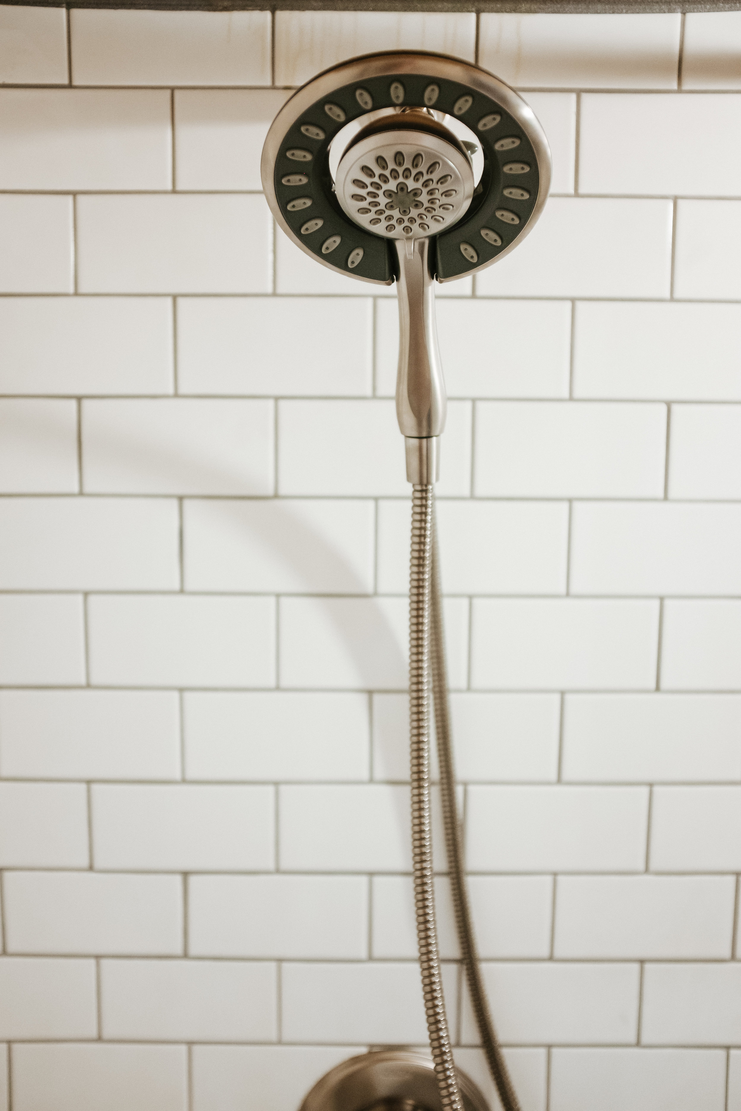 The Ironclad by Wind River Tiny Homes - subway tile shower, brushed nickel shower head