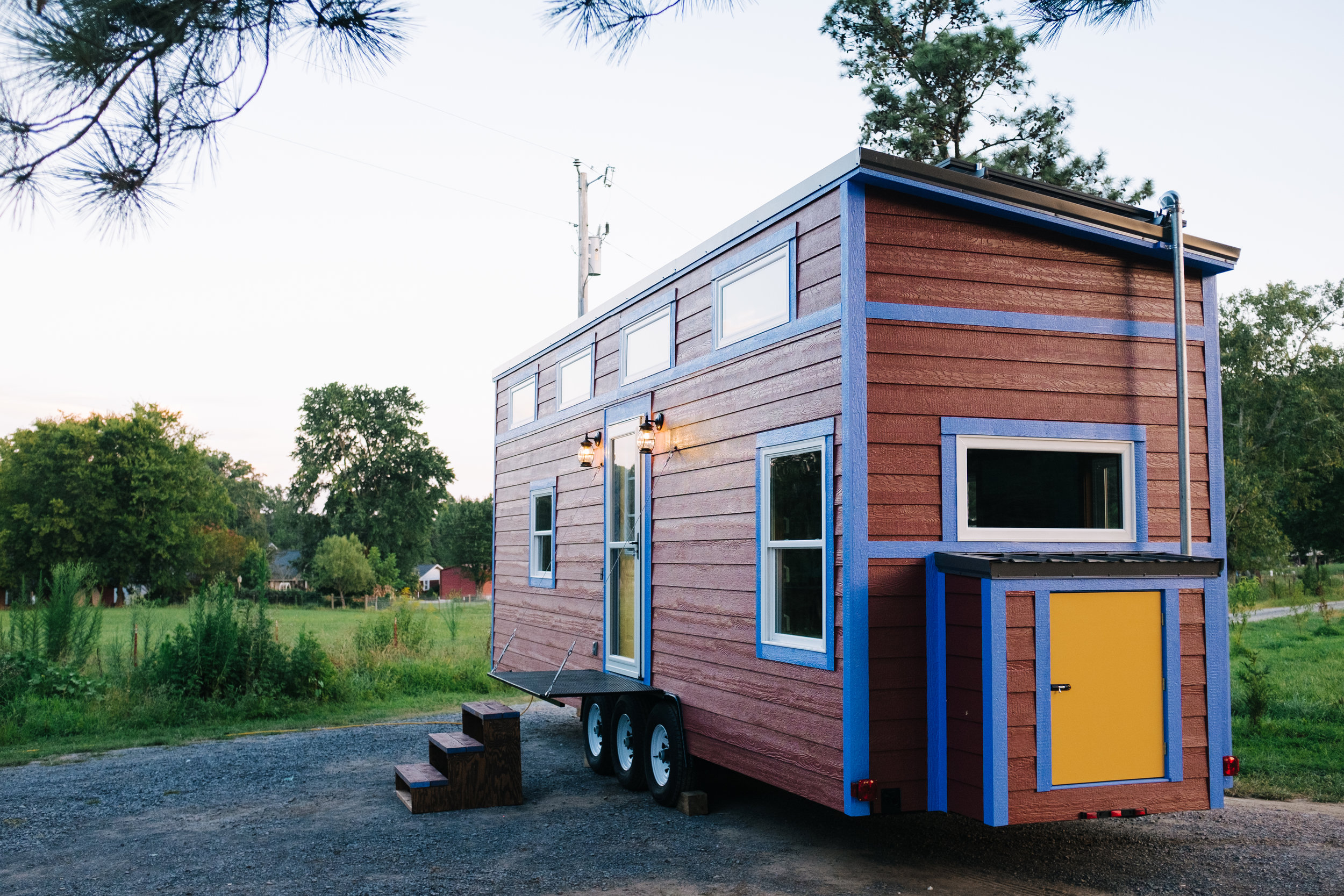 The Big Whimsy by Wind River Tiny Homes - 30' tiny home, off grid solar system, fold down porch, propane utilities, off grid home