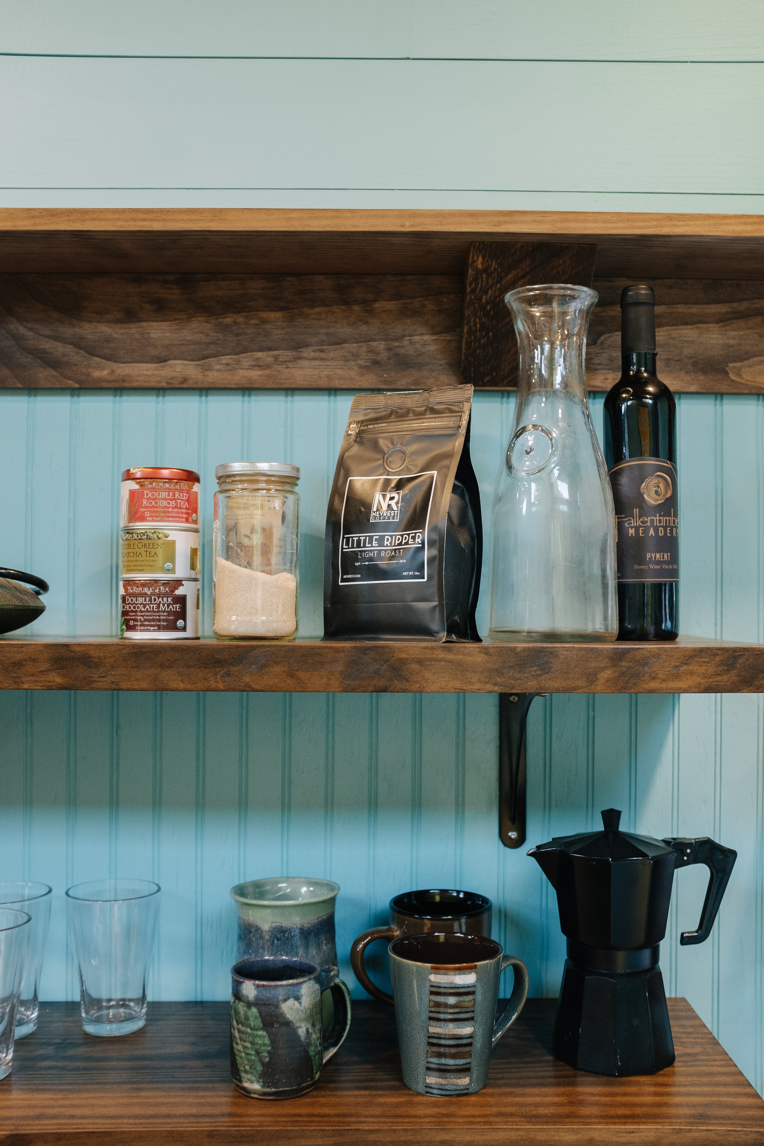 The Big Whimsy by Wind River Tiny Homes - custom penny counter top, open shelving