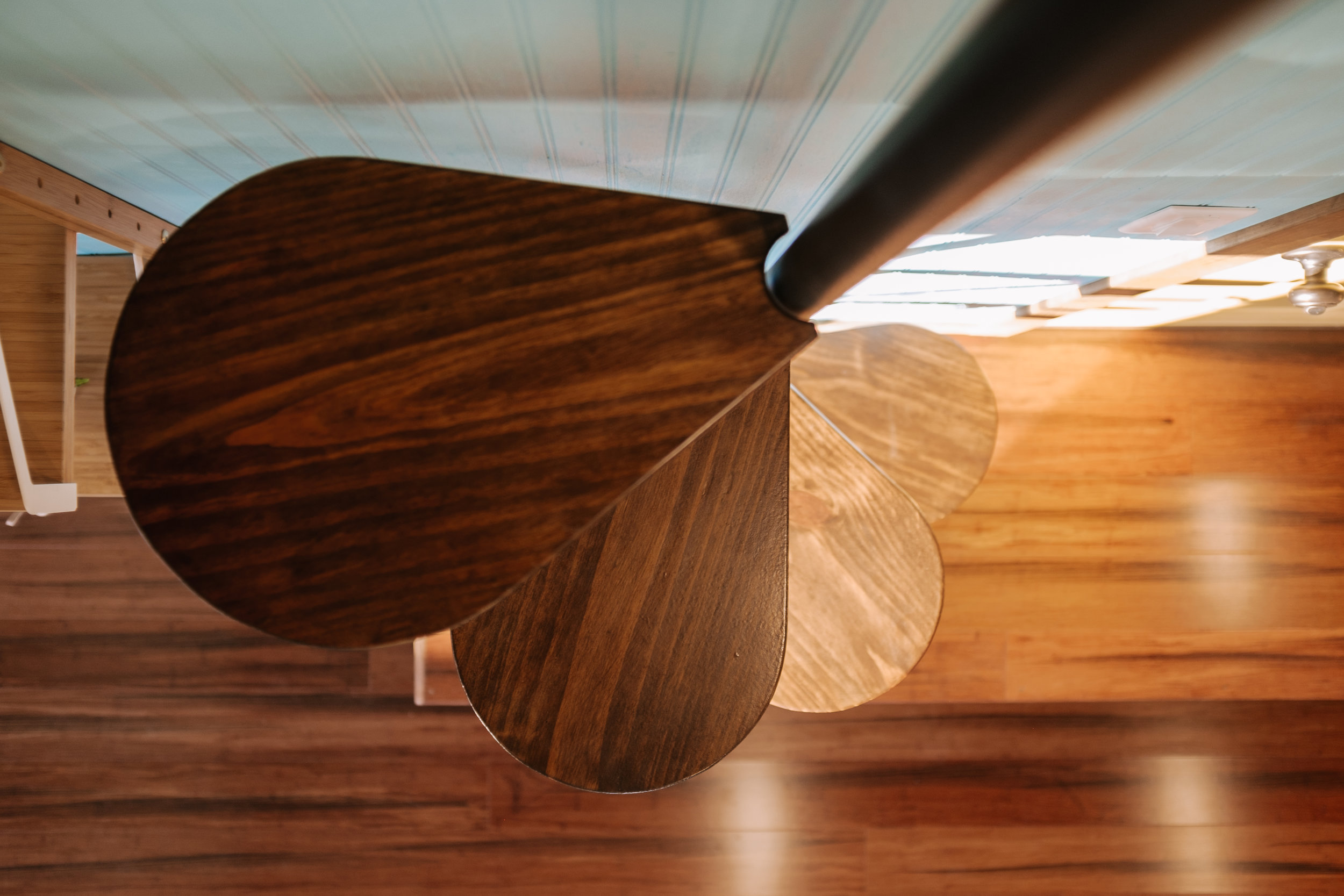 The Big Whimsy by Wind River Tiny Homes - custom lily pad spiral stairs, bamboo flooring